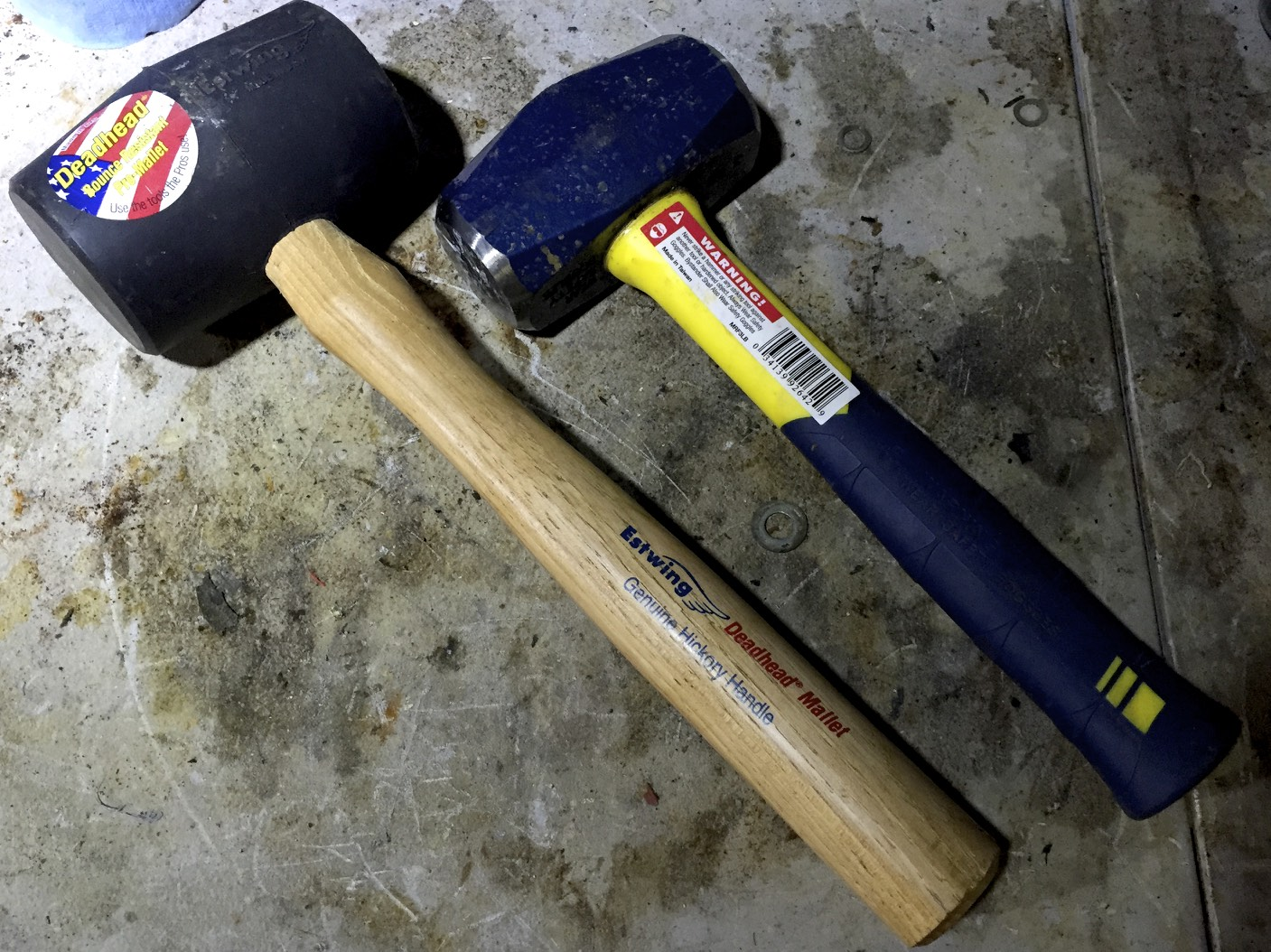A rubber mallet (left) and a four pound hammer (right).