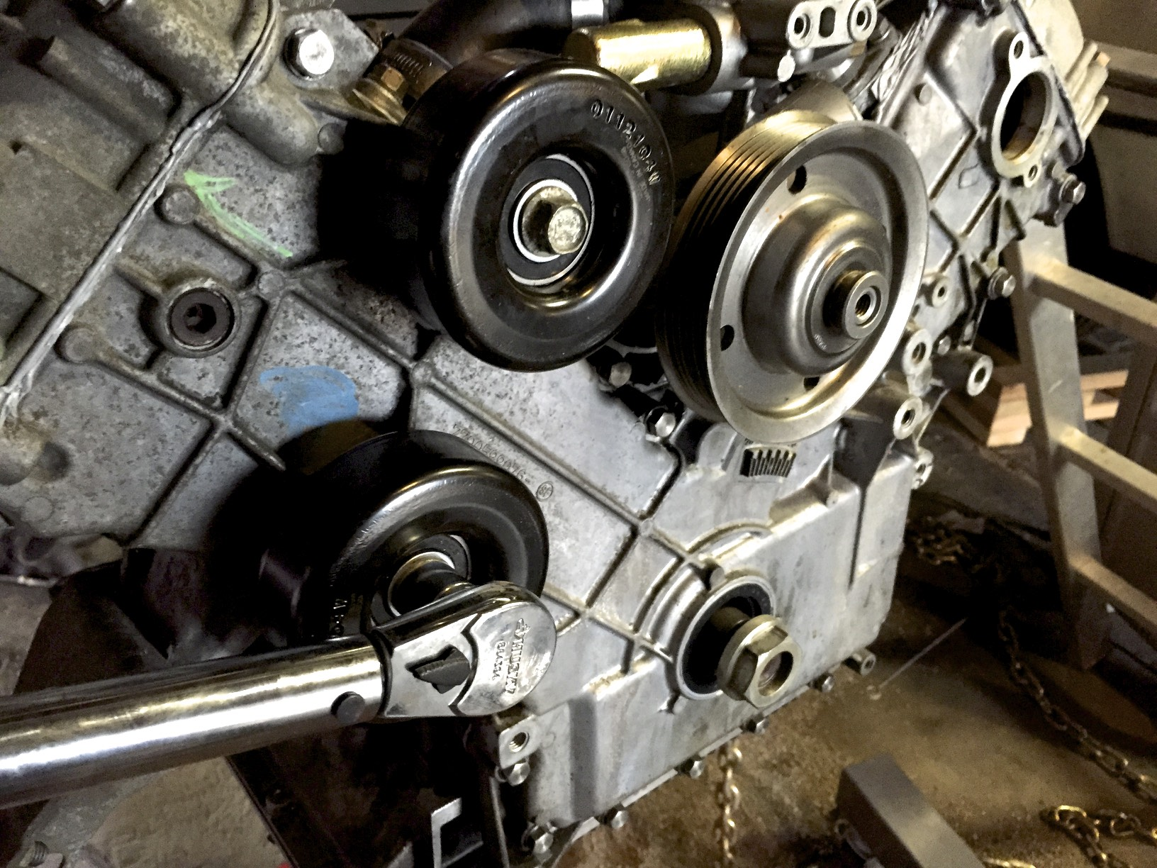 Torquing the lower idler pulley after installing the upper one.