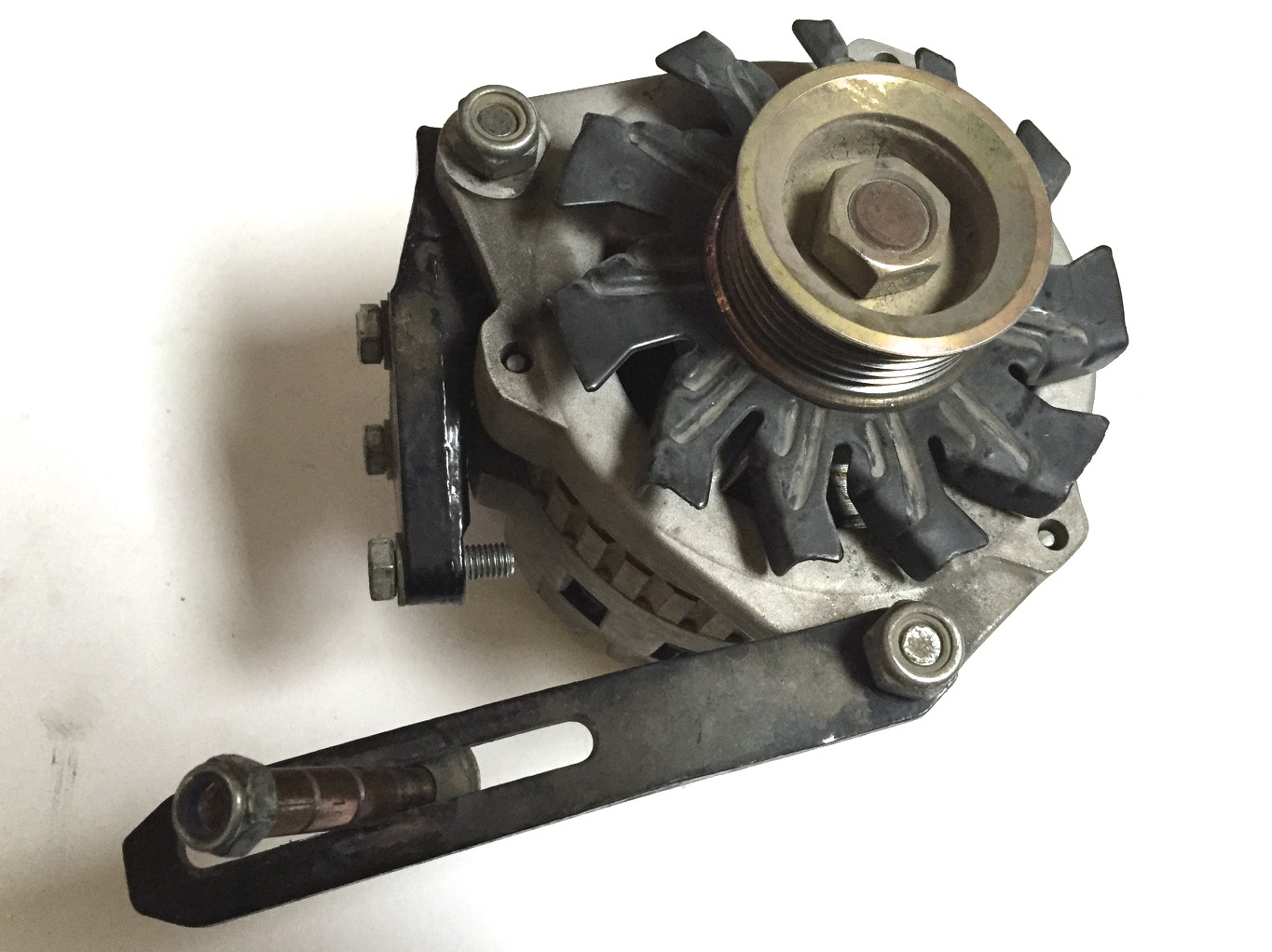 The new alternator with the mounting and adjustment brackets.