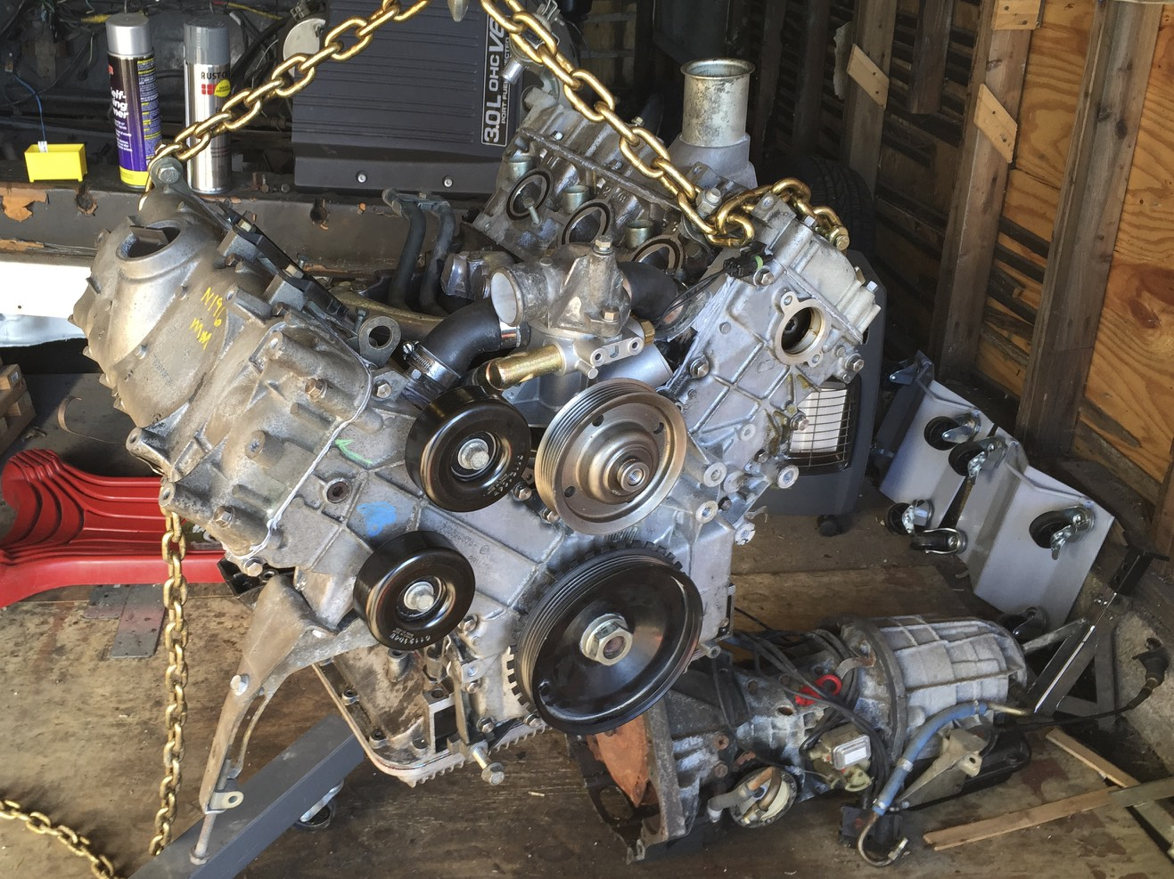 Swinging the engine around on the hoist to get mate it with the transmission.