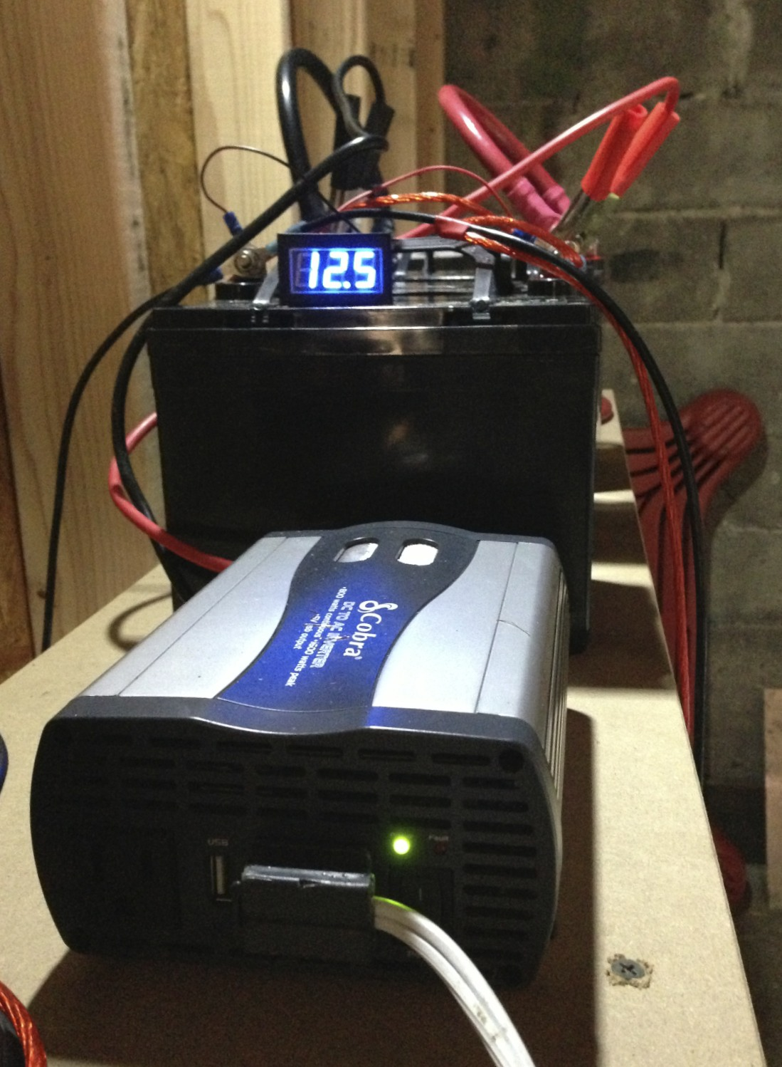 The power inverter connected to the batteries.