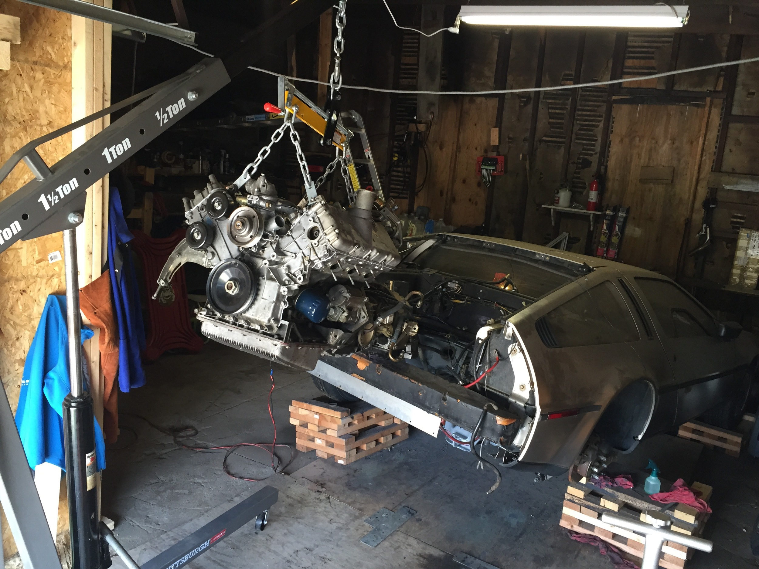 The engine lifted and ready to be installed.