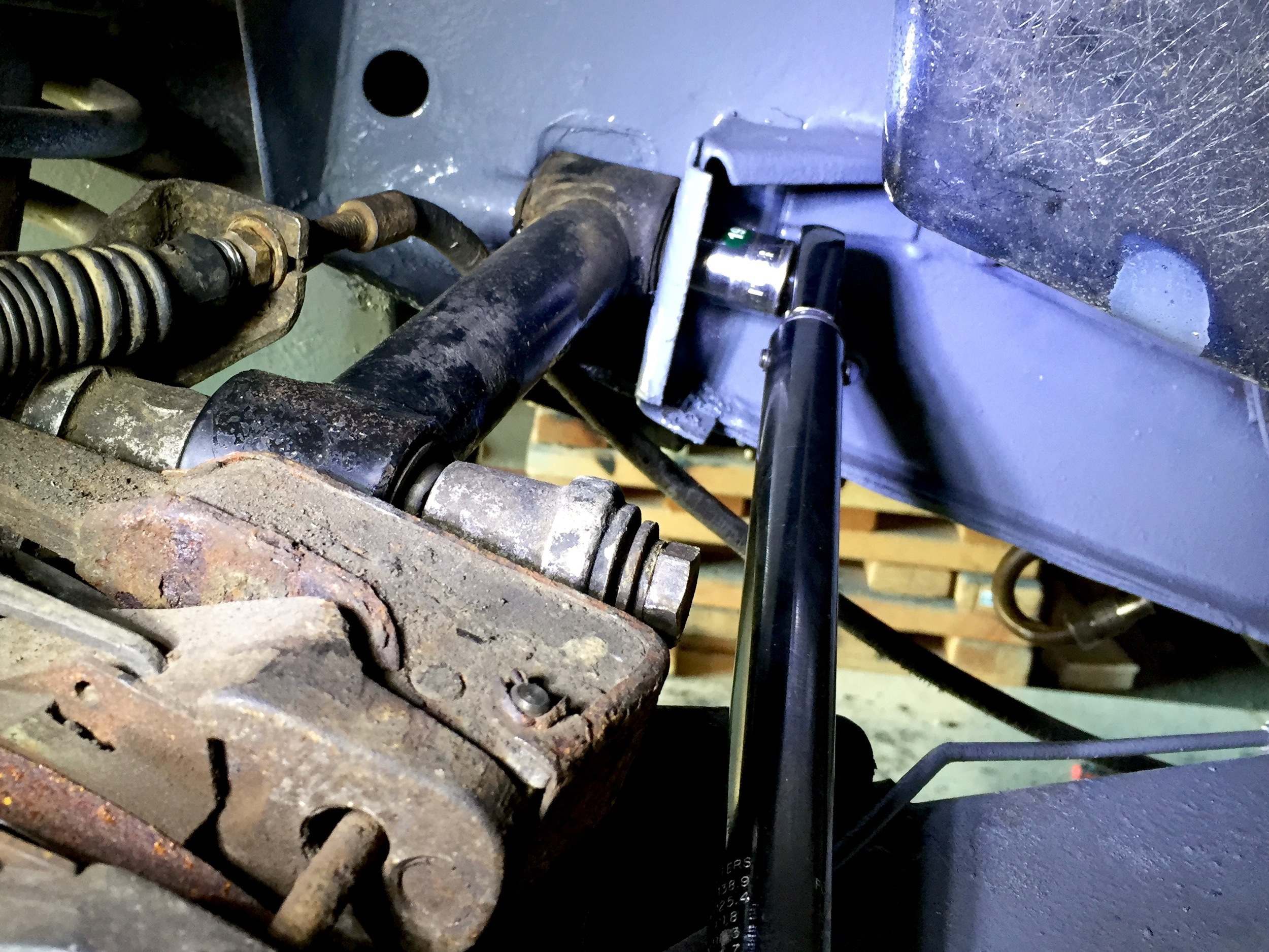 Torquing the inner link arm bolt. The outer bolt is already run through the arm and hub carrier and ready t one torqued.