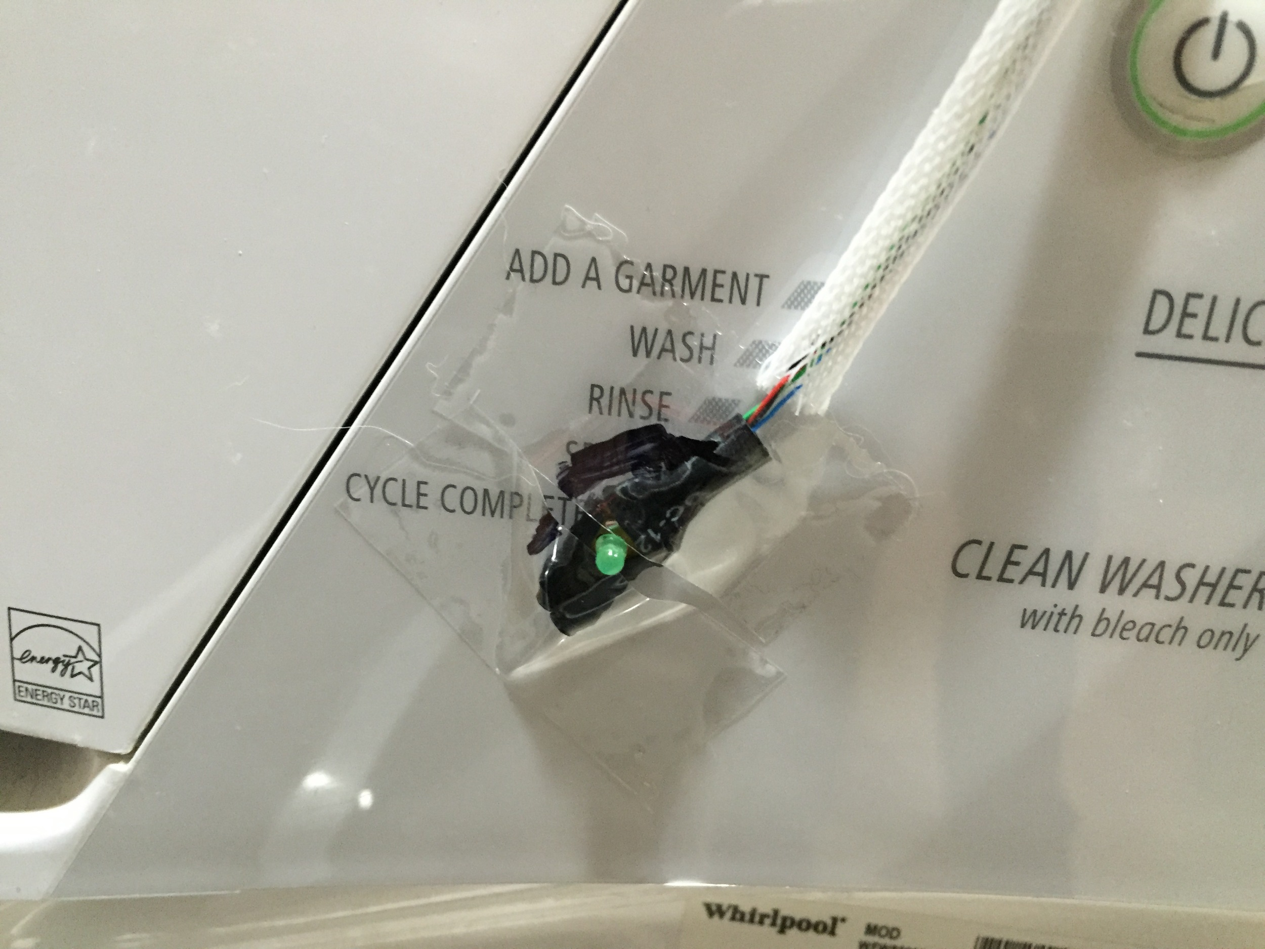 The poor job of mounting the washer sensor over the Cycle Complete LED.