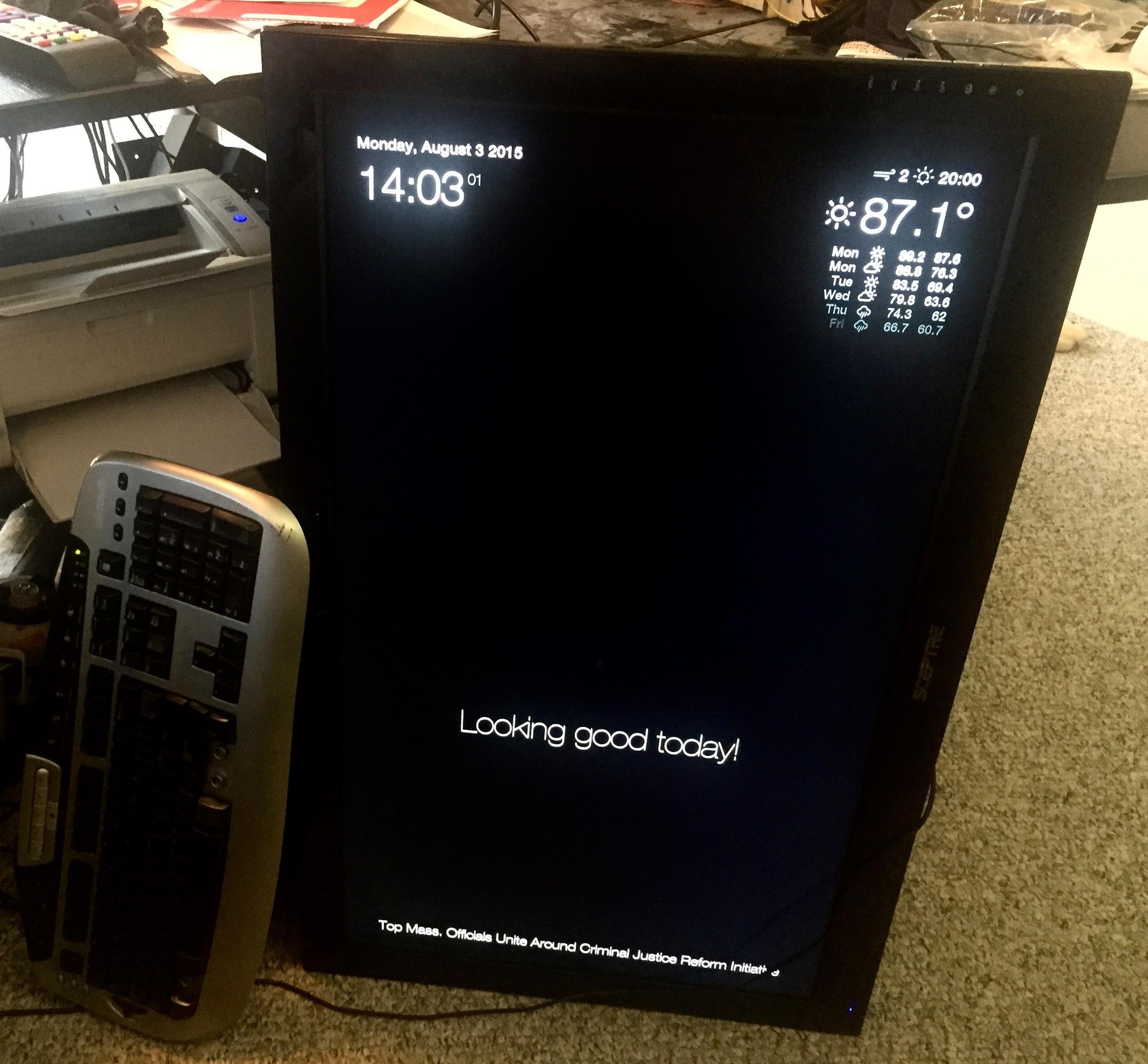Raspberry Pi installed on the sideways TV running the Magic Mirror website.