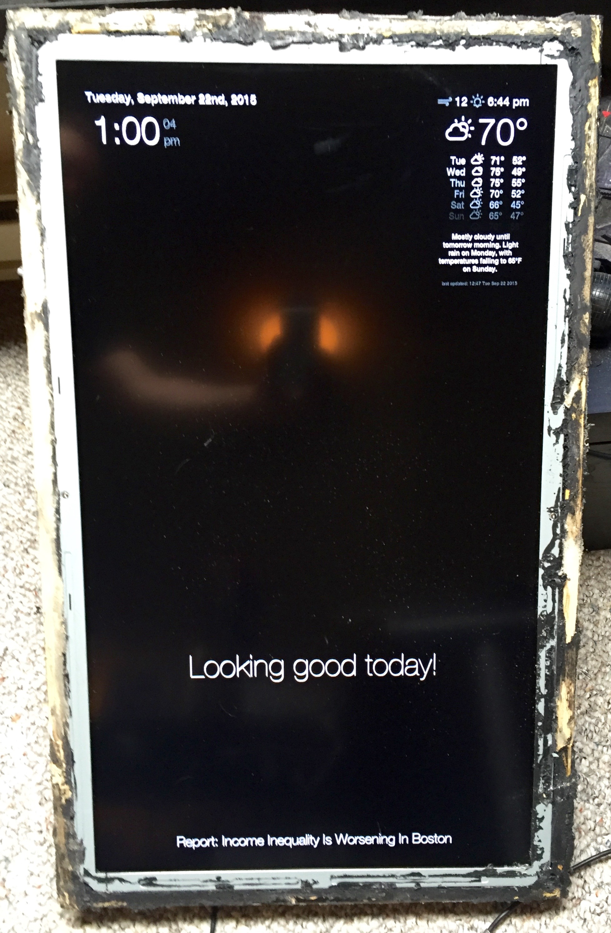 The screen and frame without the mirror, slightly damaged by the broken glass.