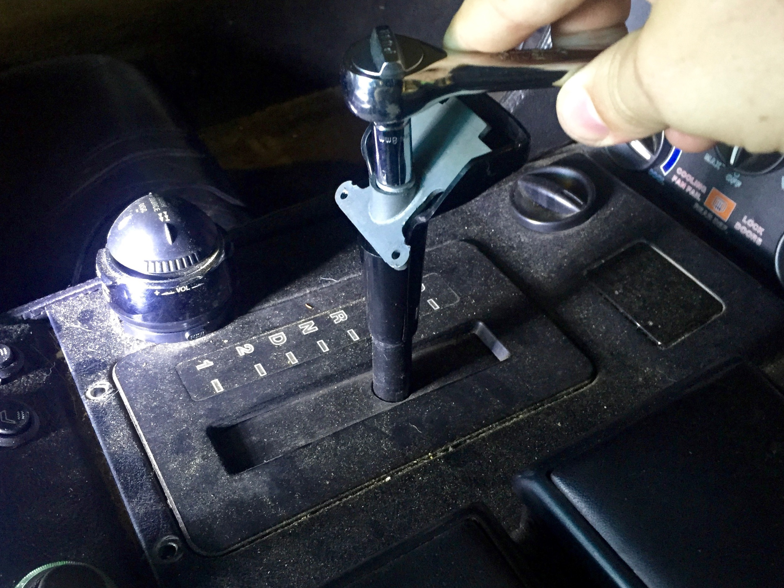 An 8mm socket removes the nut holding the shifter together.
