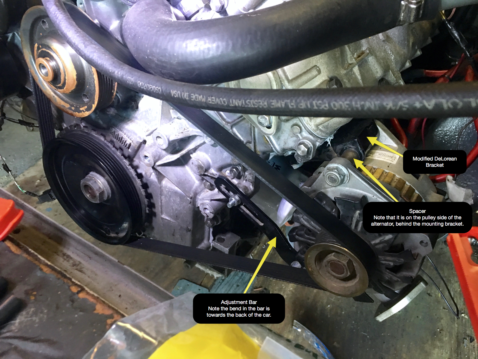 The correct installation of the alternator. Notice the location of the spacer and the orientation of the adjustment bar.