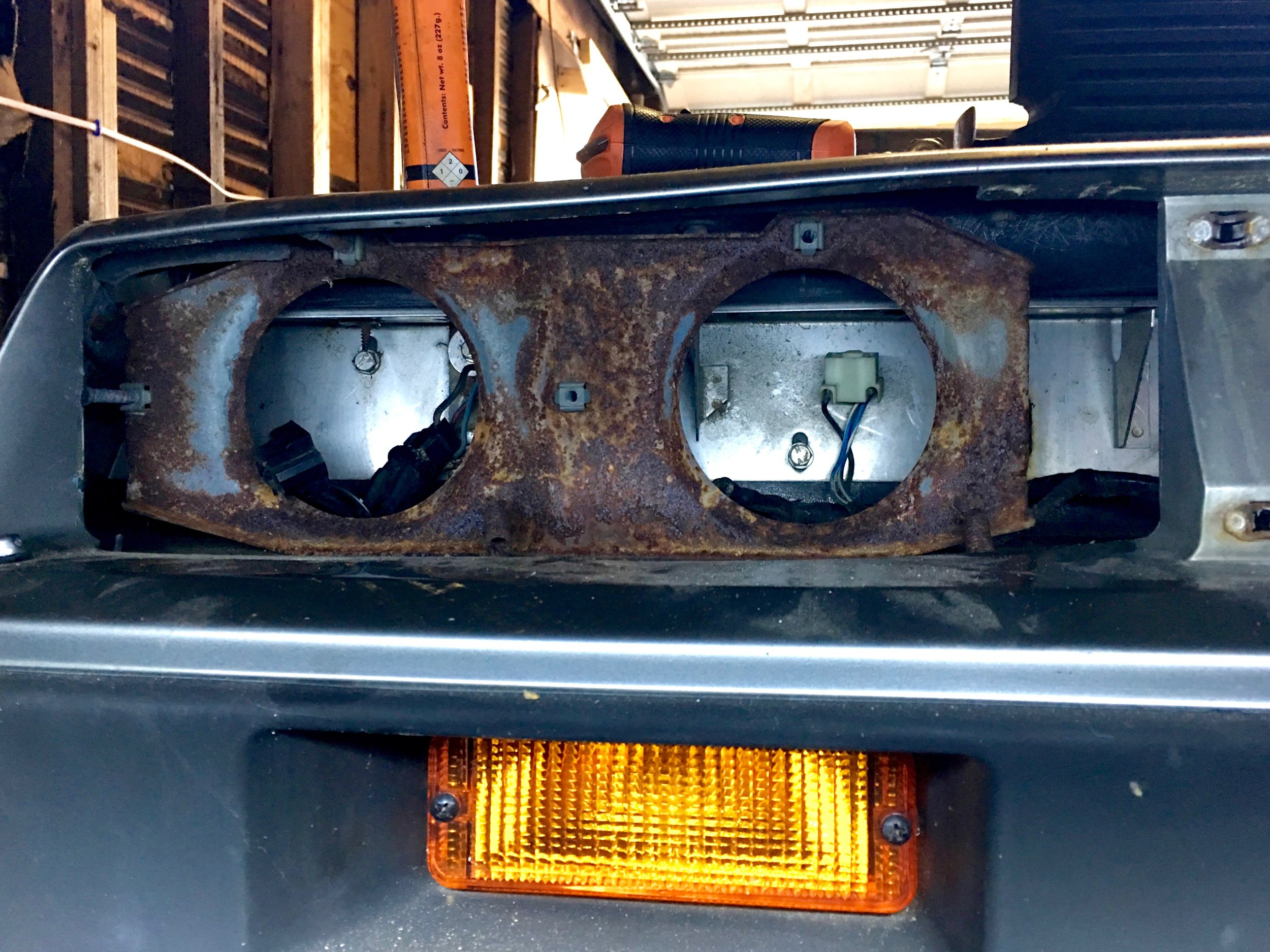 Rusted headlight frame.