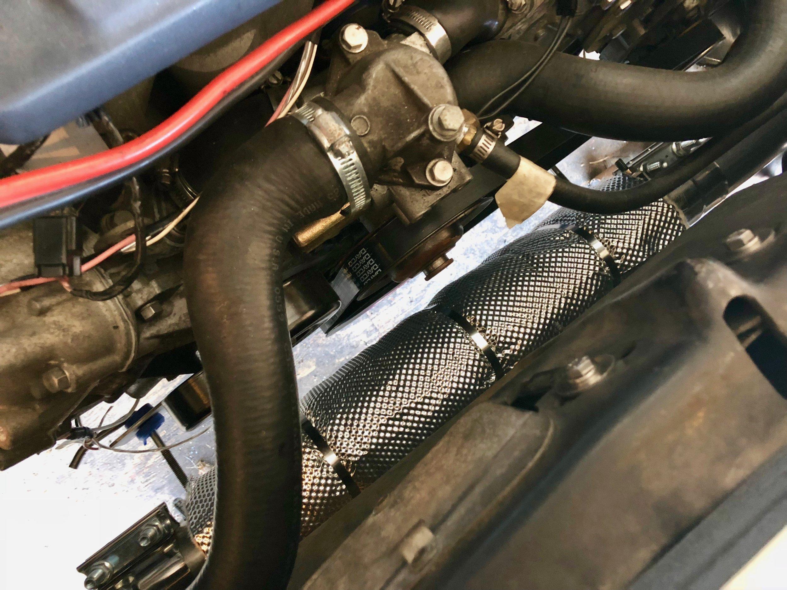 Heat Shield Product's Muffler Armor installed around the muffler.