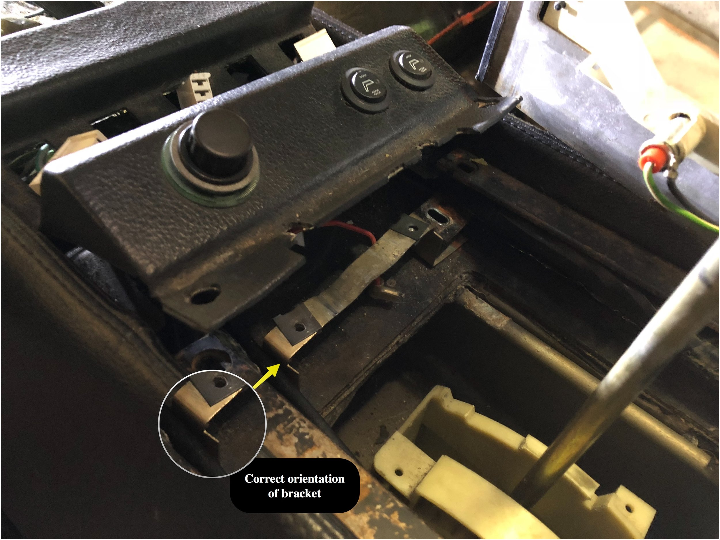 The correct orientation of the shifter plate mounting bracket.