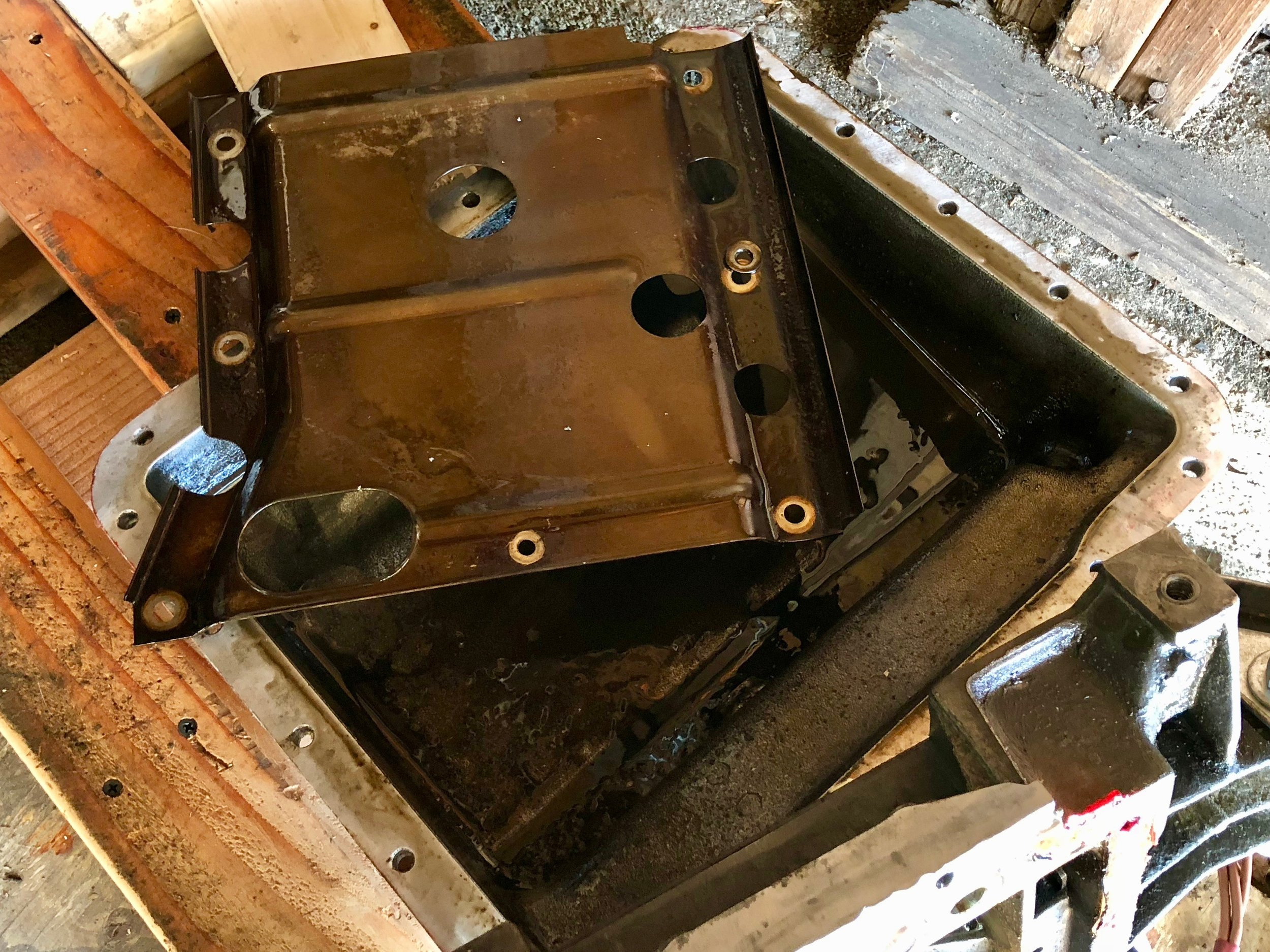 The baffle and pan soaked with oil, proving that there was oil in the engine -- it just wasn't moving out of the pan.