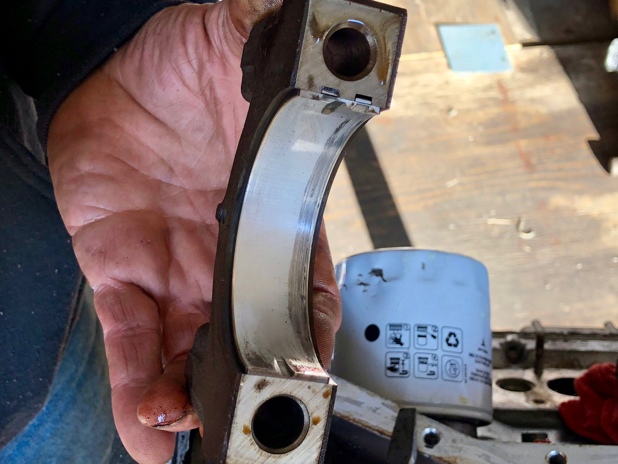 A look at another one of the bearings, showing scratches from running without lubrication.