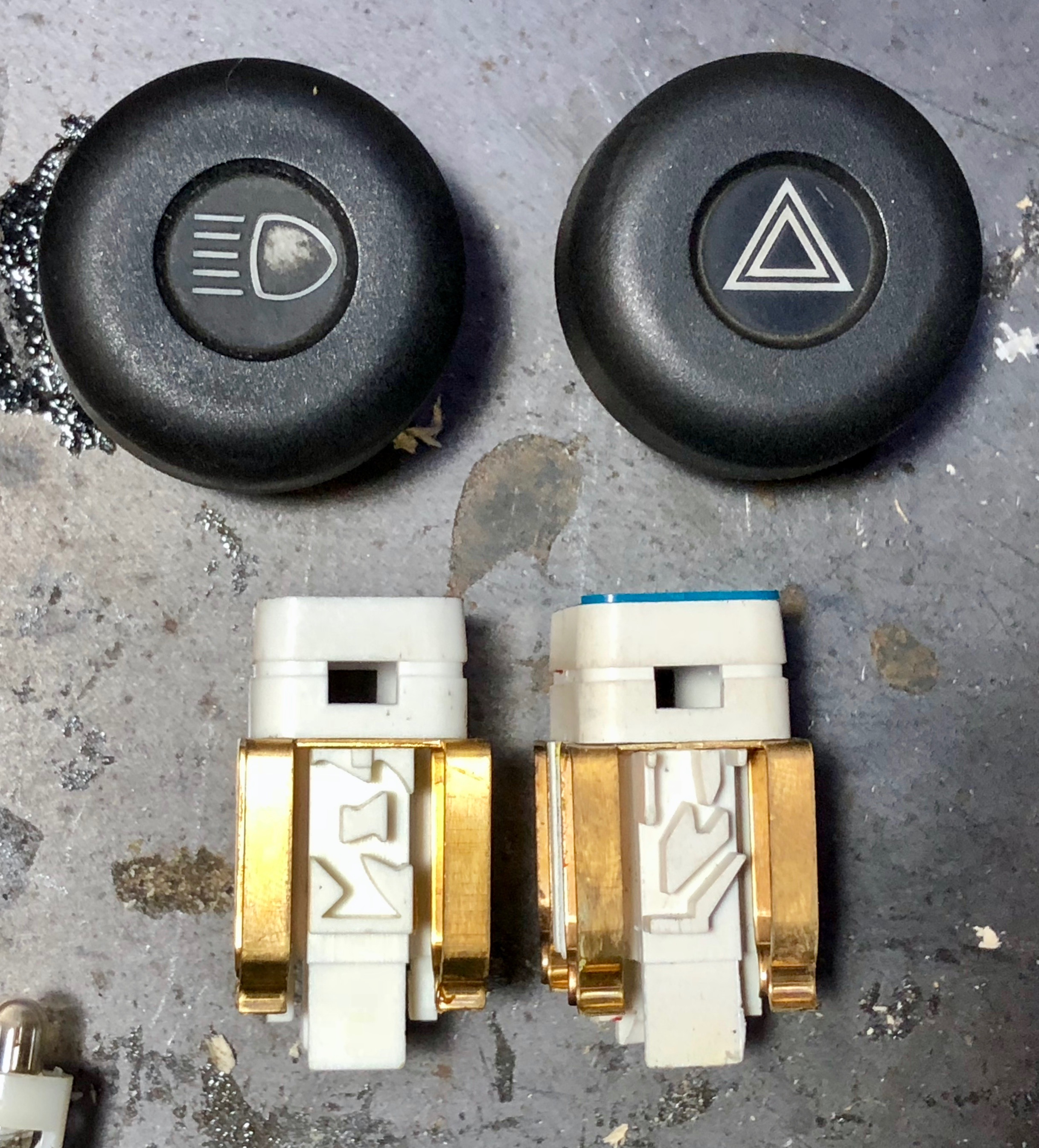"""The mazes that the """"L"""" arm follows for the the headlight switch (left) and hazard switch (right), allowing the switch to lock into two or three positions."""