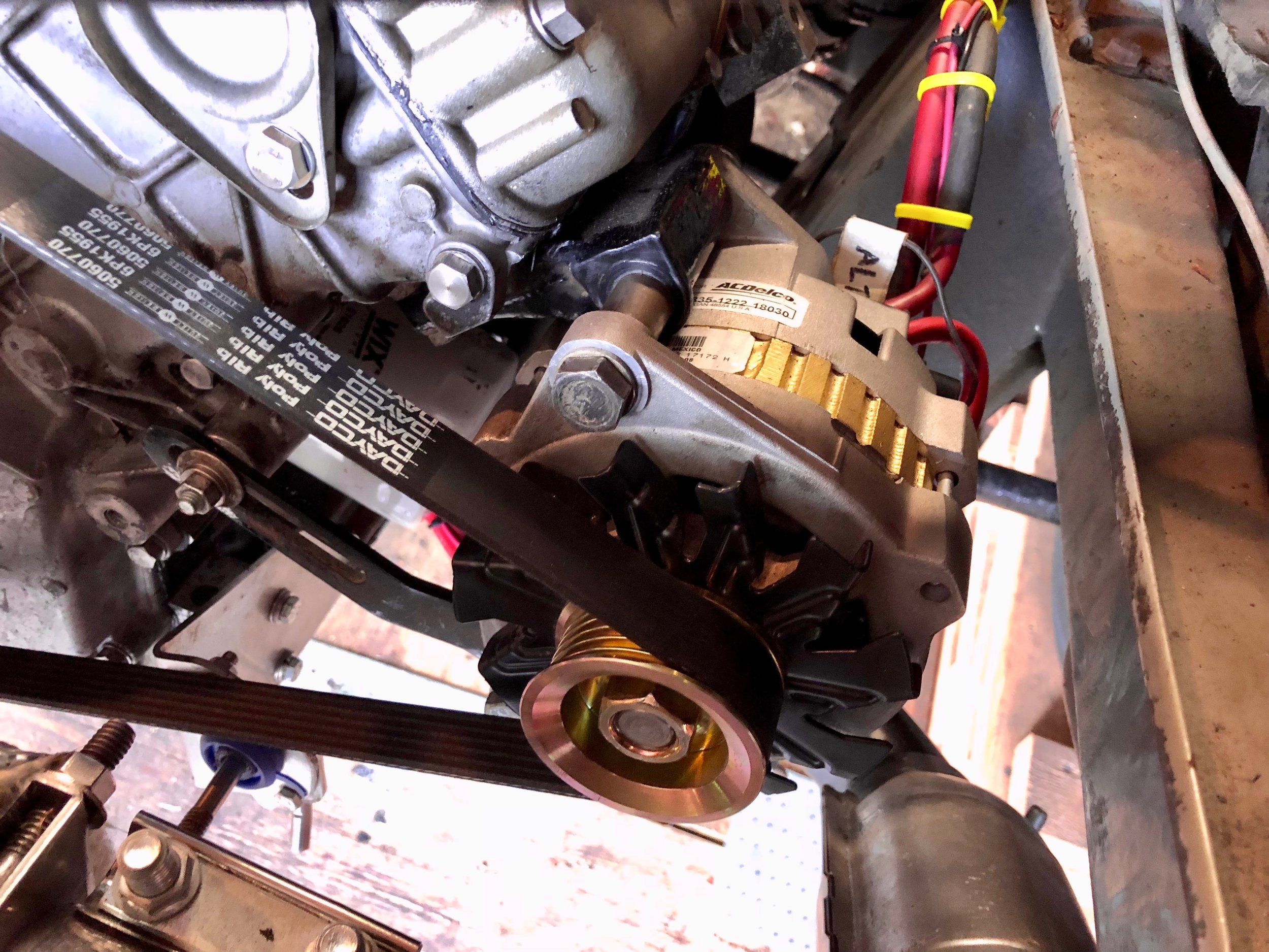The modified alternator installed on the engine.