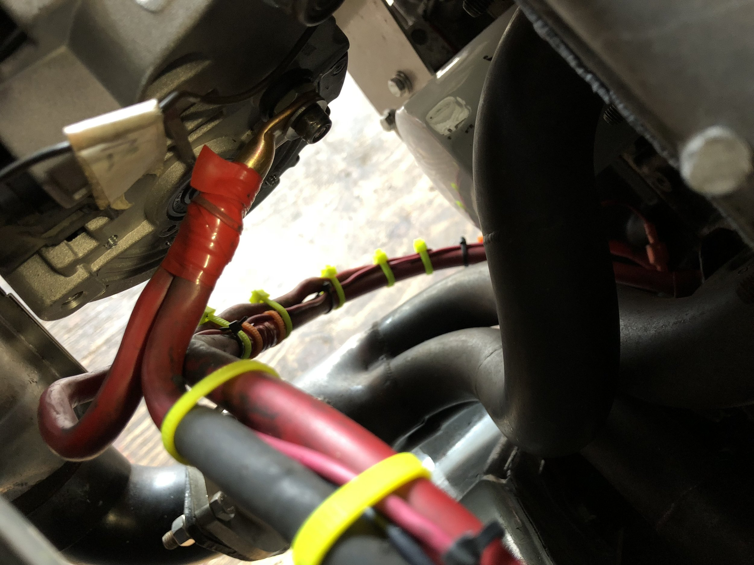 The modified battery cables jointed with a single connector on the alternator.