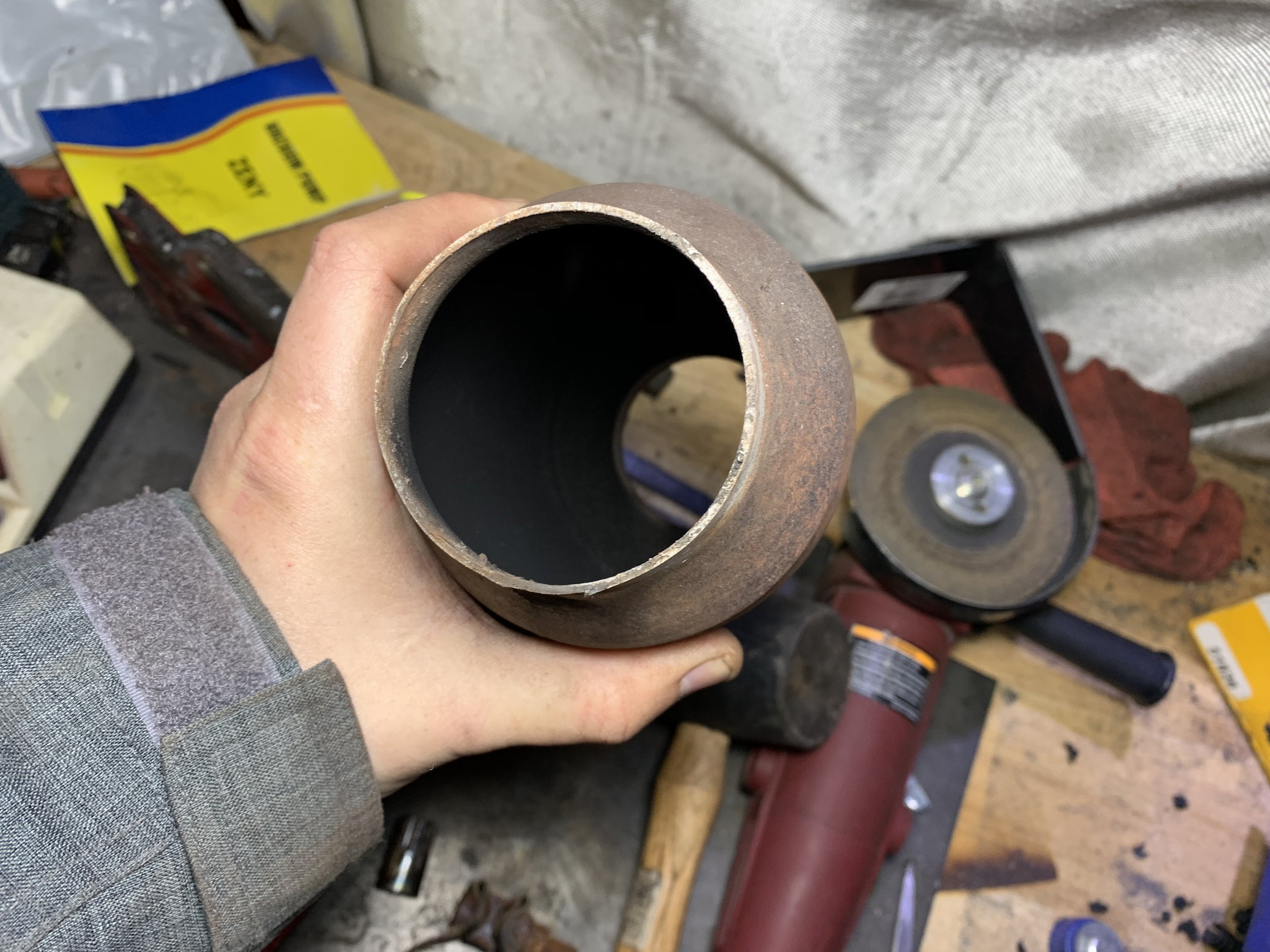 This used to be a catalytic converter. Now it's just a pipe.