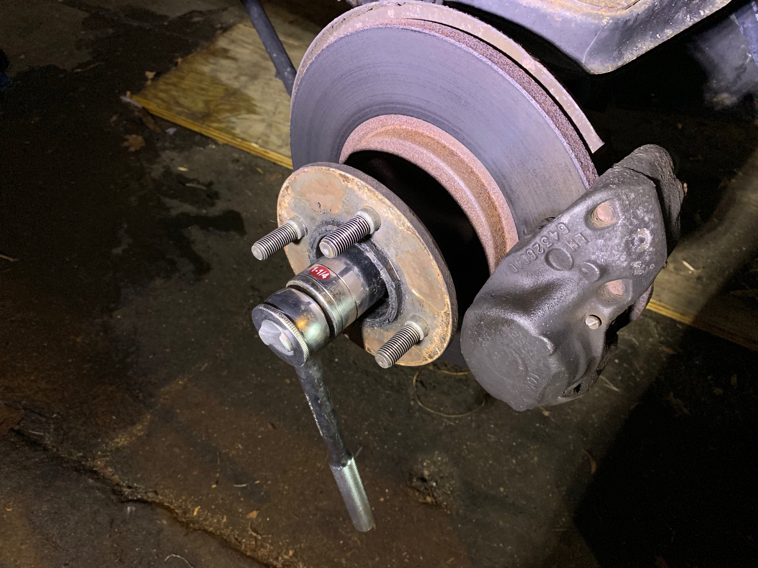 "Using a 1 1/4"" wrench to remove the center nut."