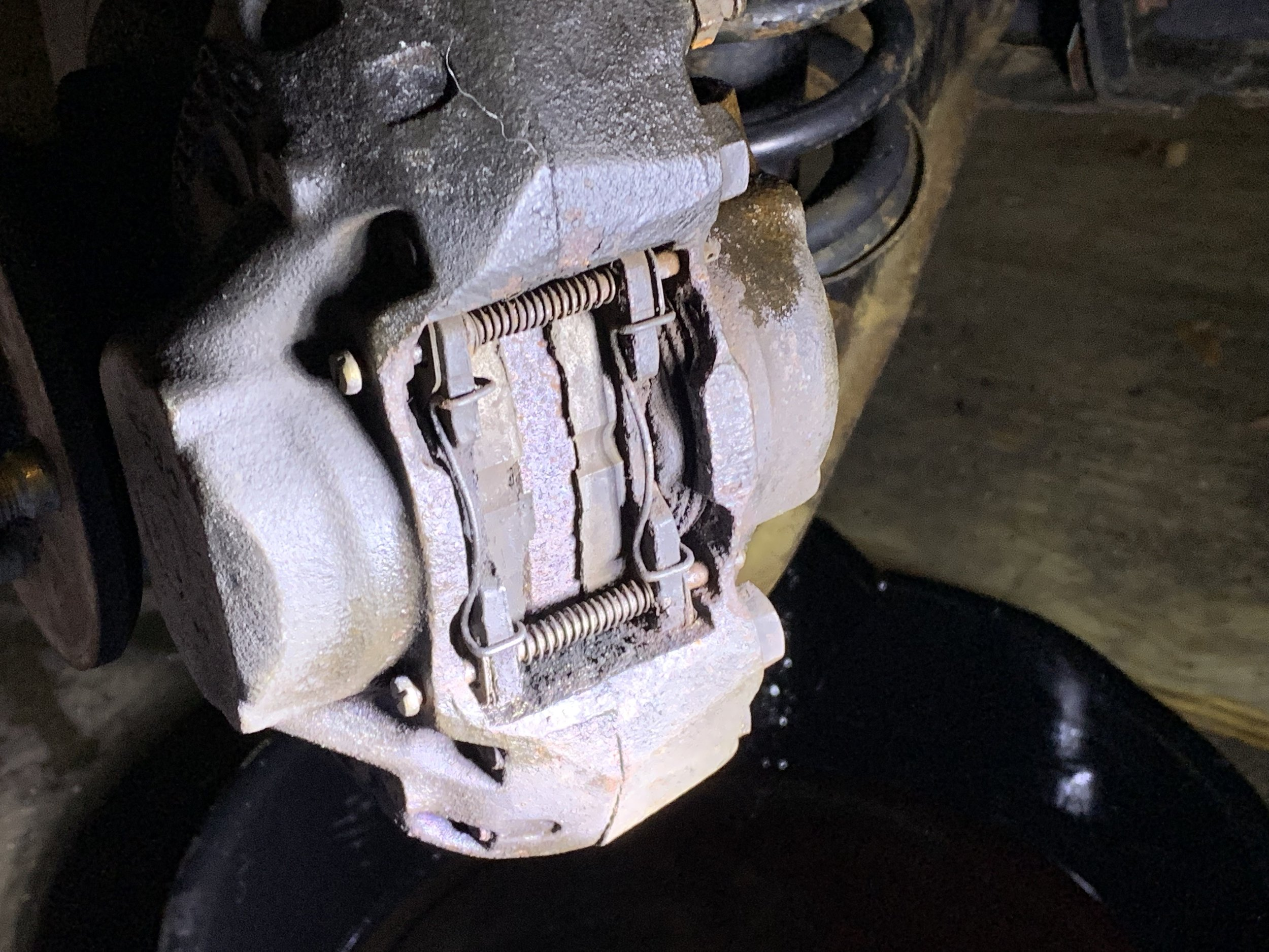 The brake pads still installed in the calipers
