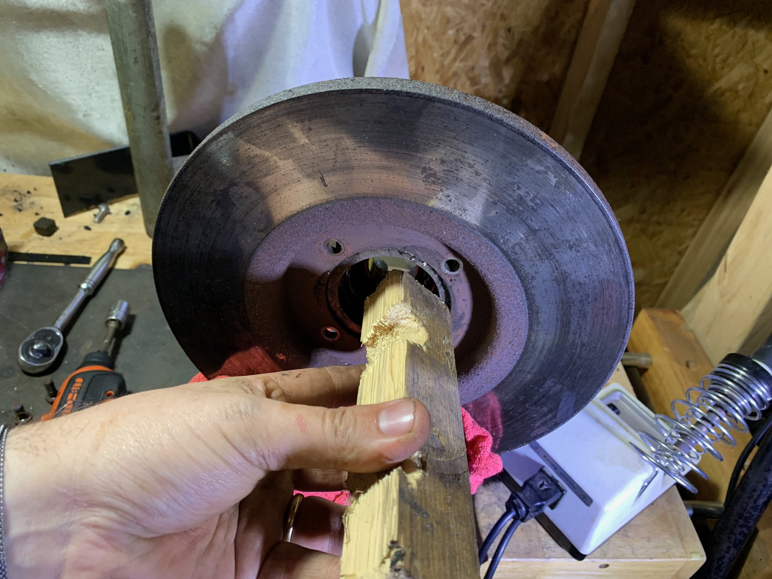 Placing a piece of wood against the bearing allowed me to tap out the hub with a hammer without damaging anything.