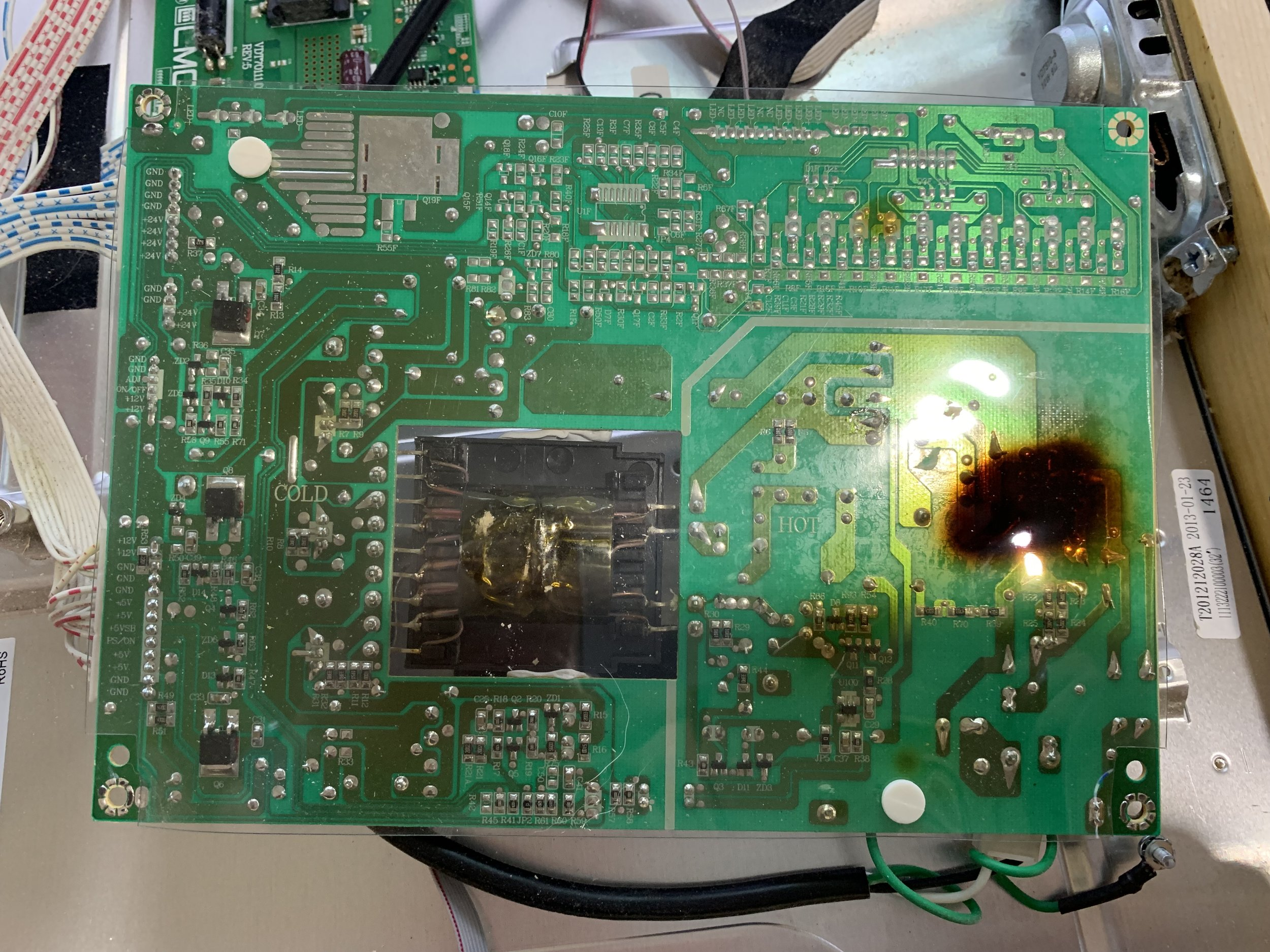 The large burn mark on the protective plastic shield.  Oddly the board itself was not marked.