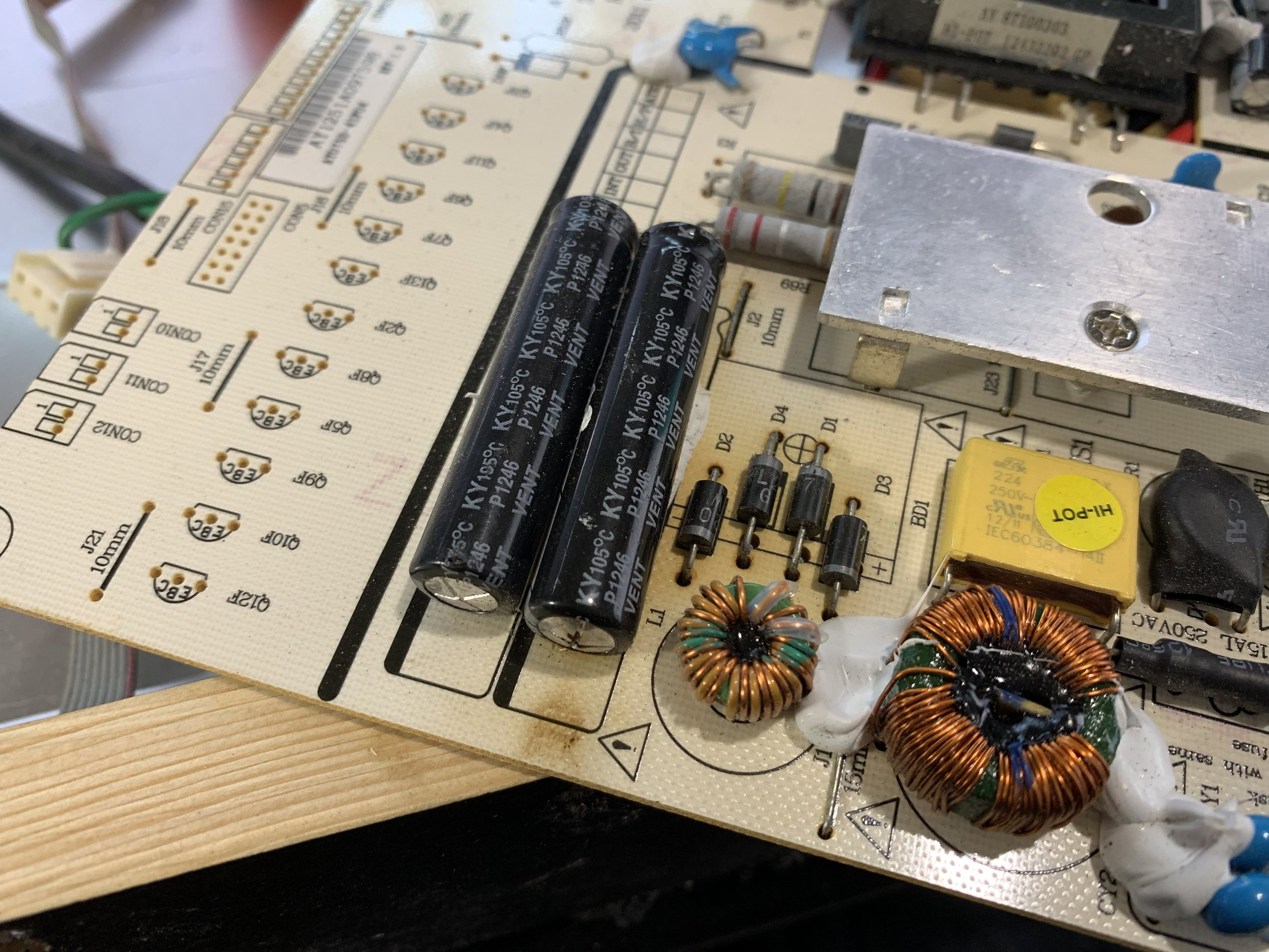 The rightmost large capacitor has a bulge and burned out end.  The four diodes next to it also read as bad when tested with a multimeter.