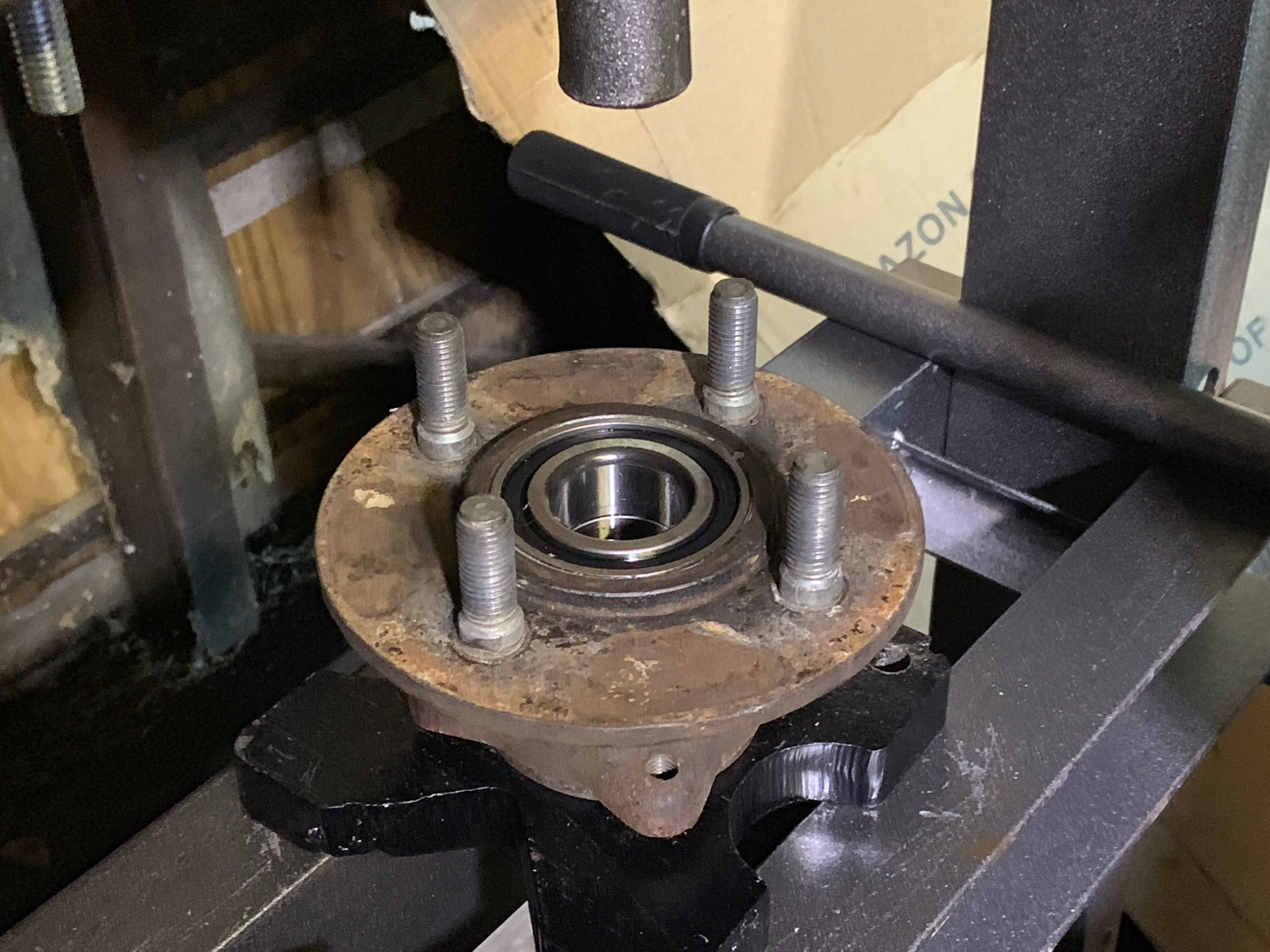 The new bearing pressed into the hub with the plate, bringing it flush to the surface. It still needs to be pressed in further by using the old bearing as a pusher.