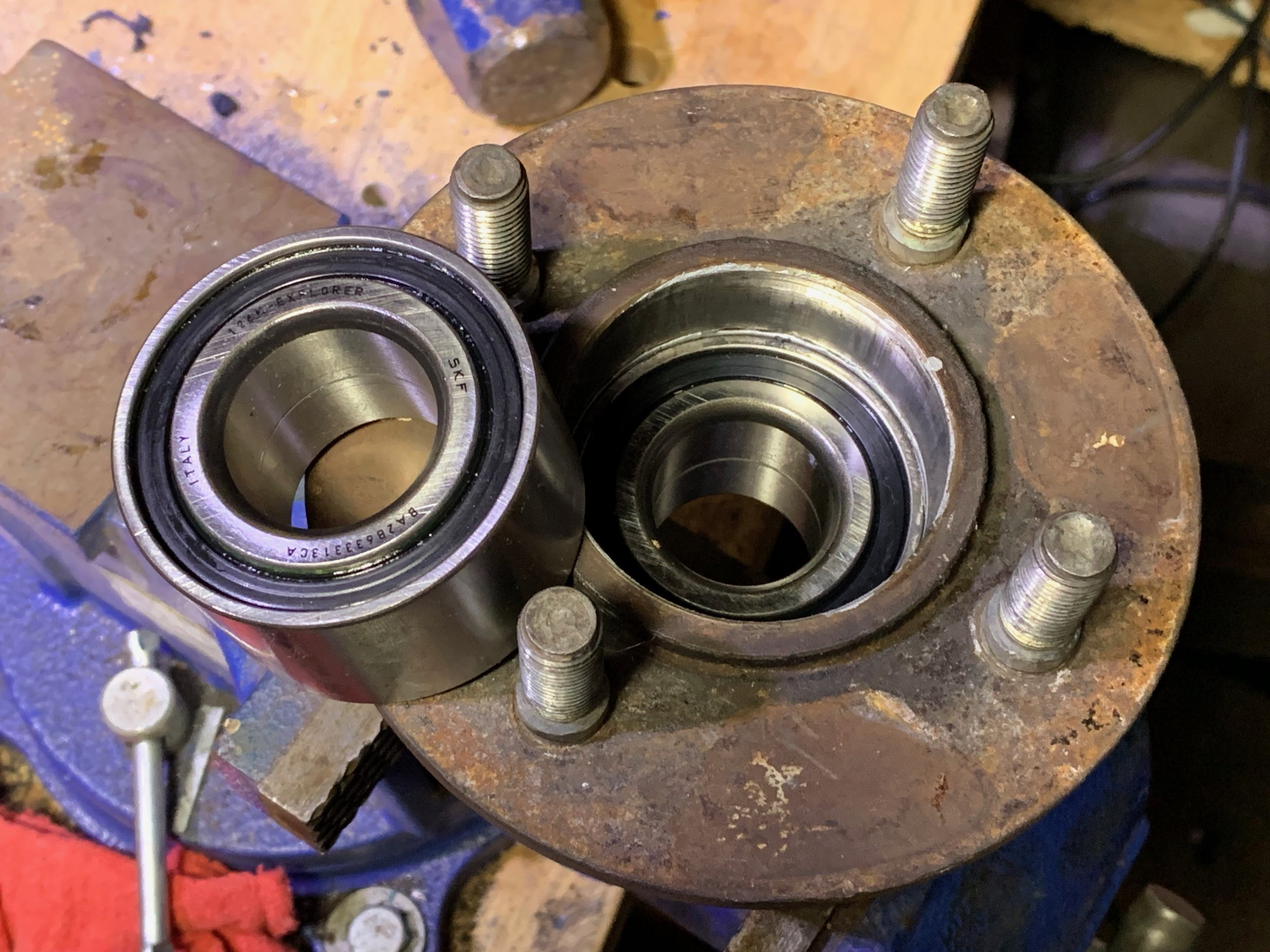 The new bearing fully pressed in, with the other bearing ready to go for the other hub.