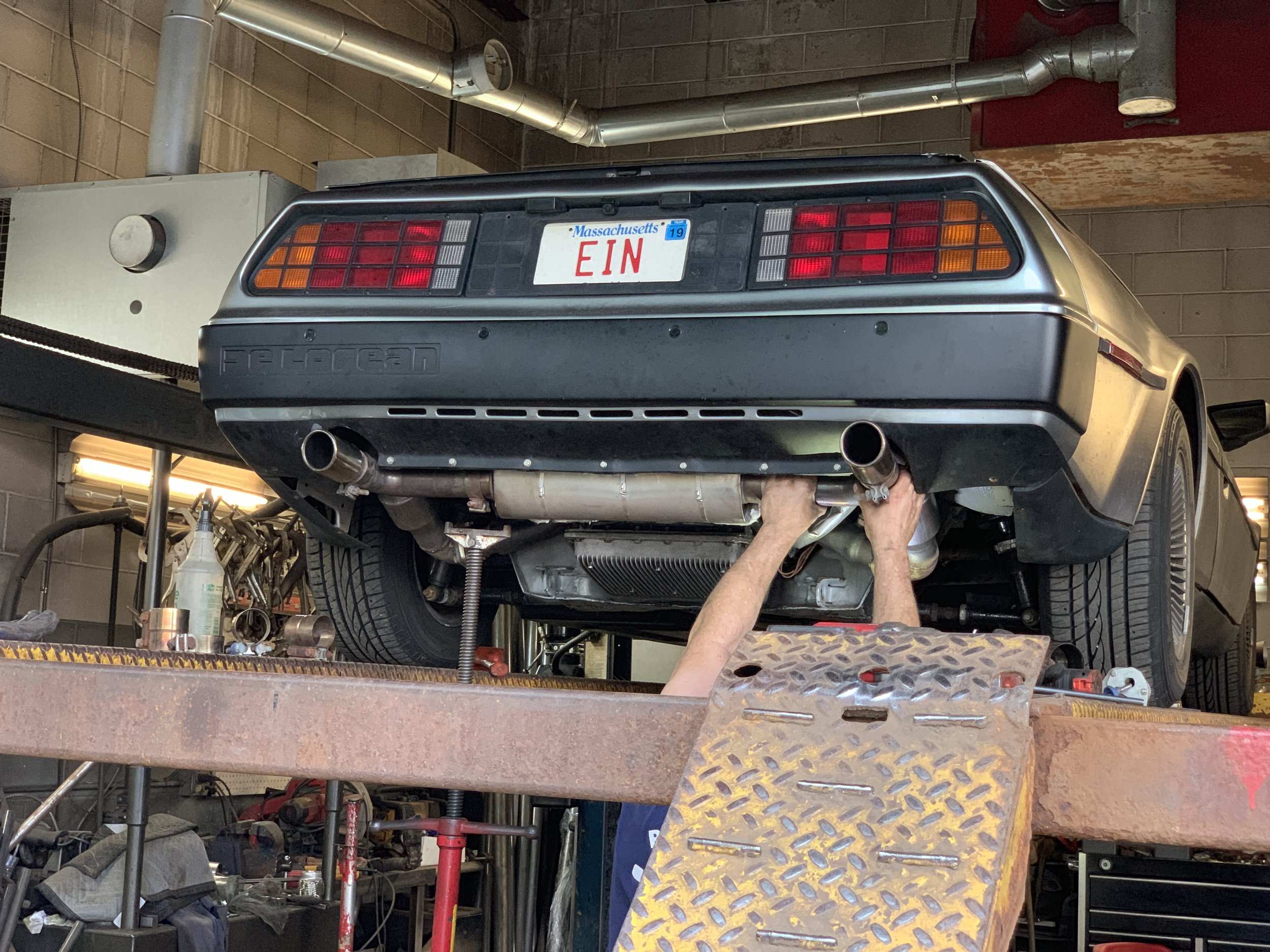 The exhaust being re-installed with new cats.