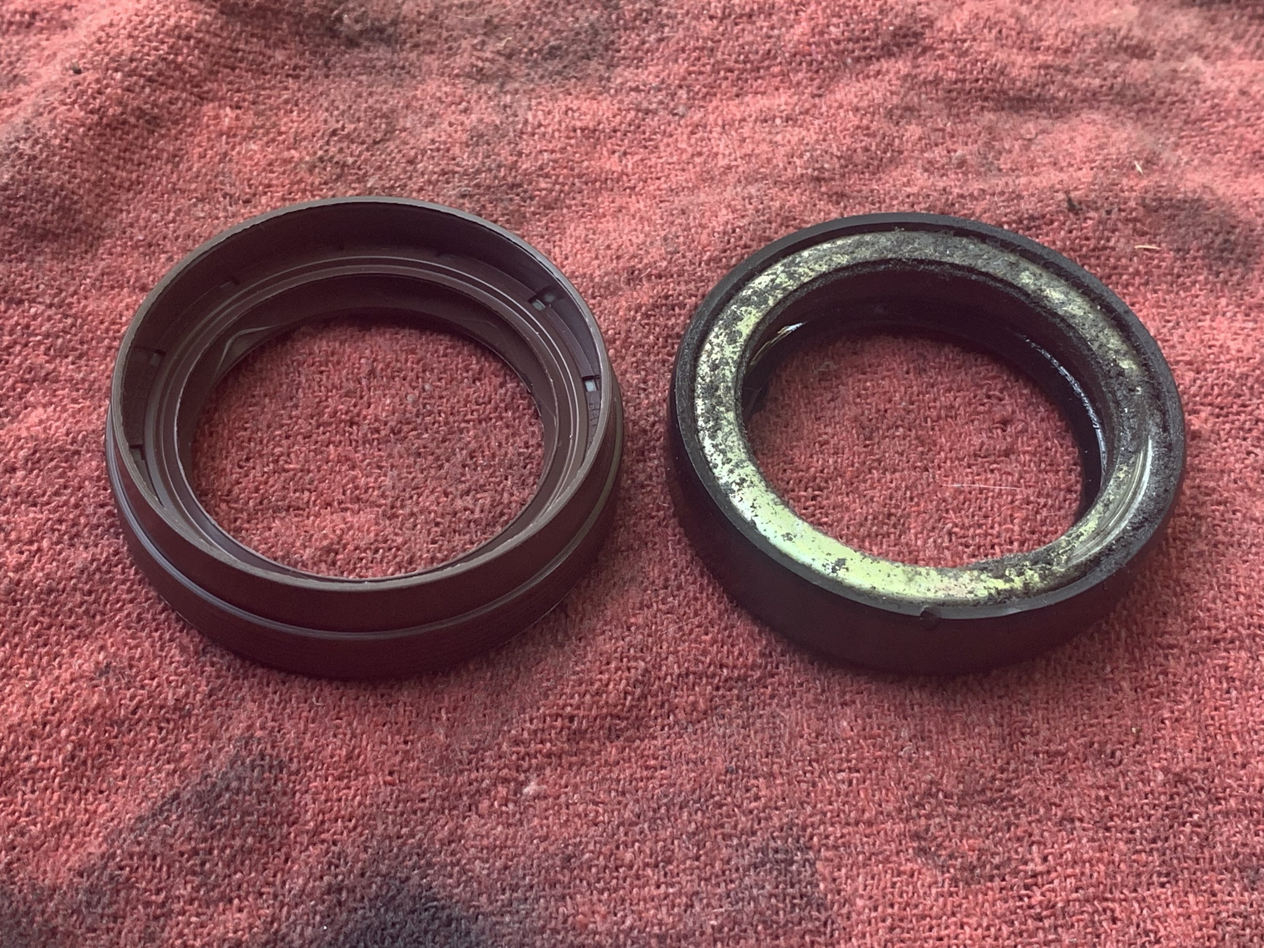 The new triple lip seal(left) and the original seal (right).