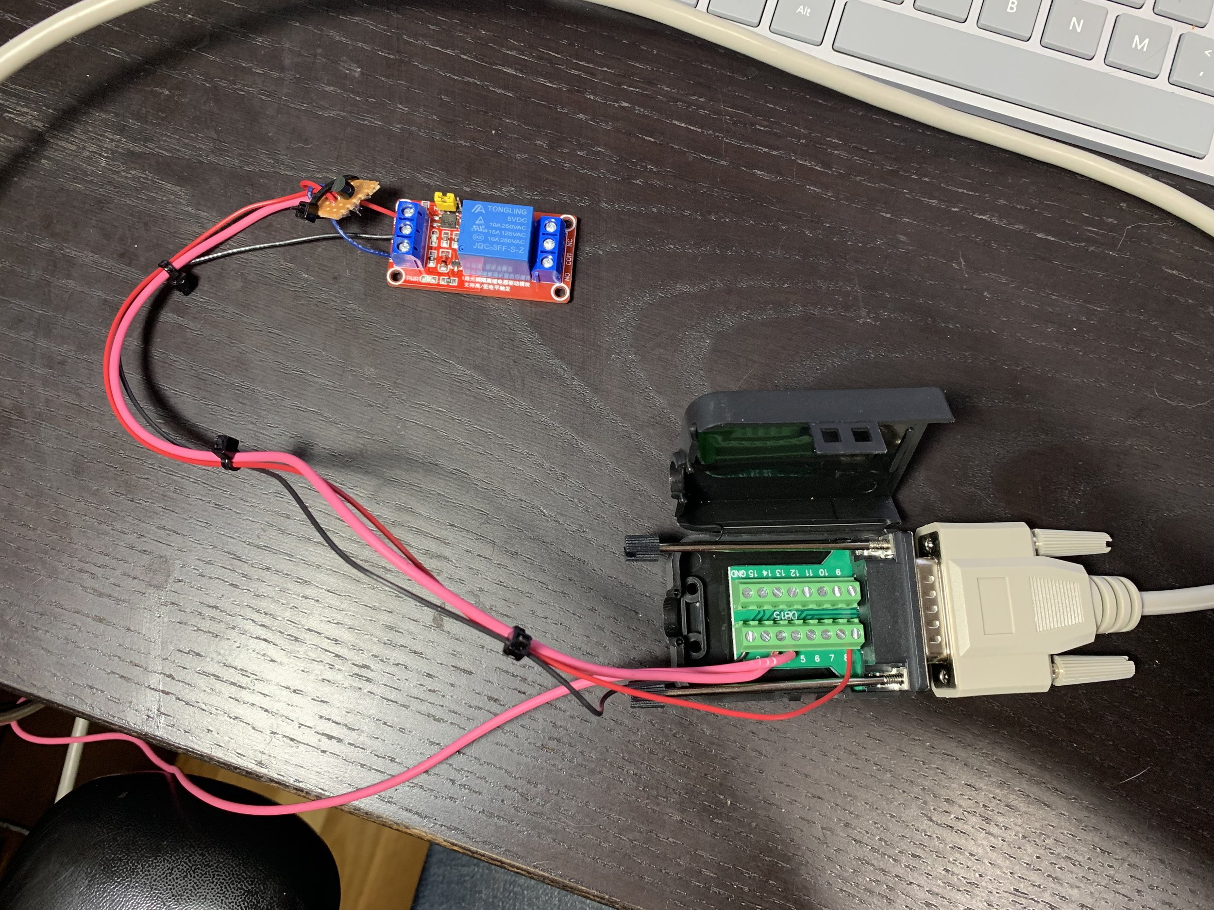 The DB15 connector running to the relay board and the externally mounted MOSFET. The other pink wire is for the input from the mode switch to tell MegaSquirt that the A/C is on.