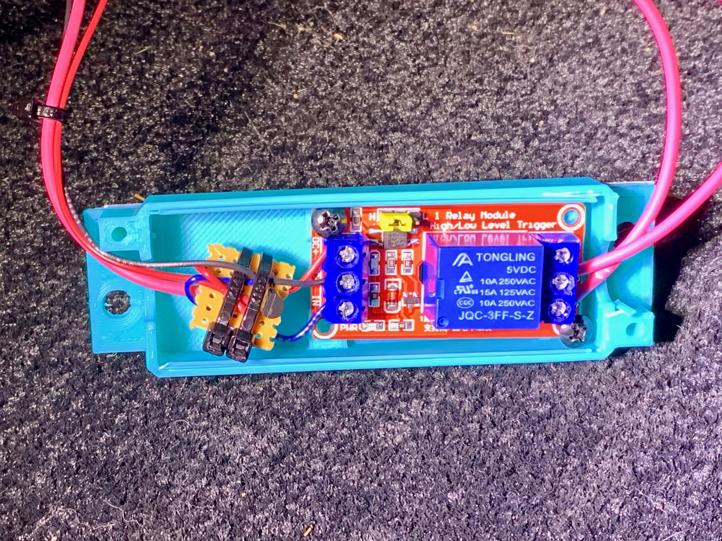 The relay board screwed into the case. The transistor board just floats freely inside.
