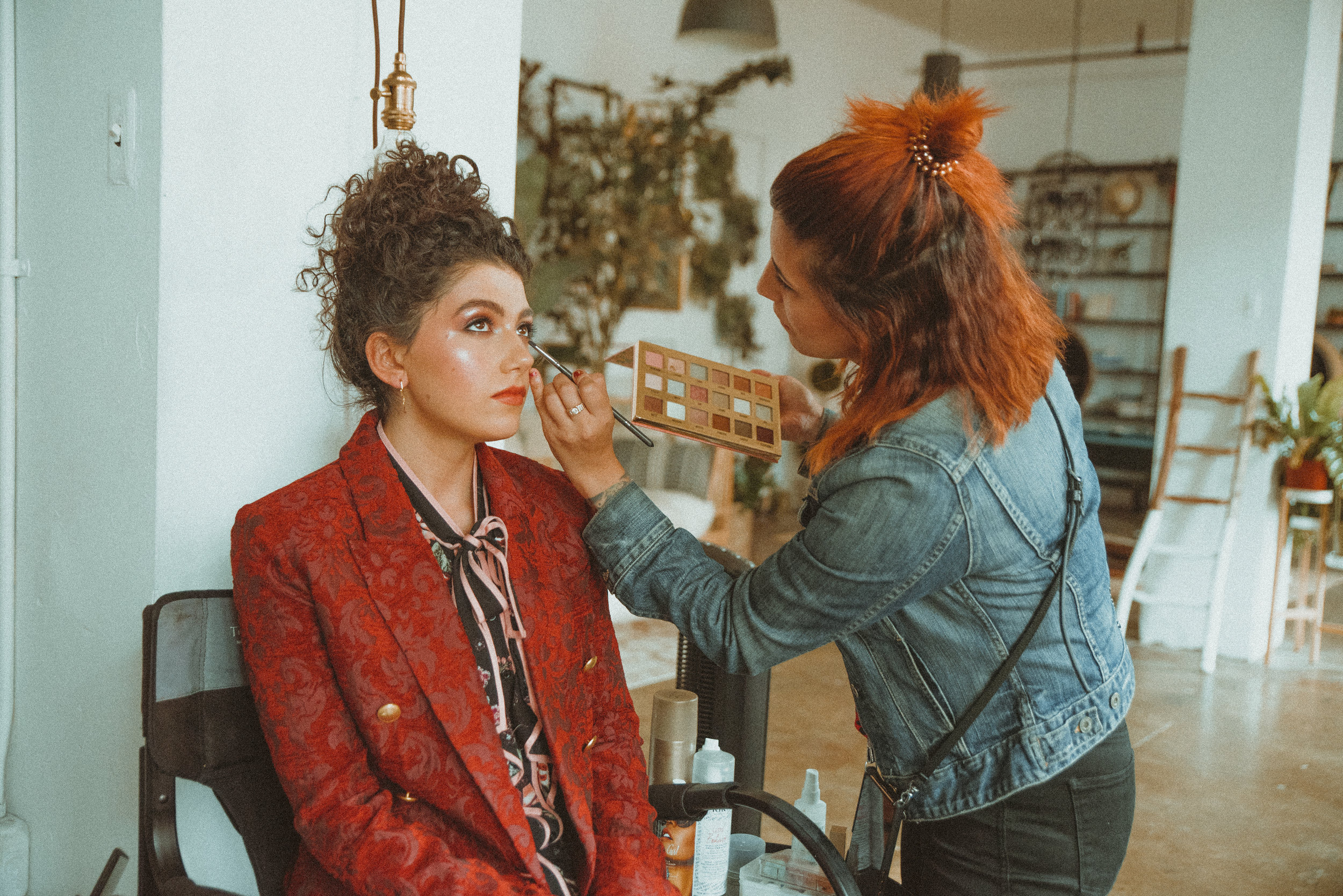 Image by Heather Koepp Photography | Cici Andersen applying makeup on a photoshoot for Saturne Magazine featuring Caroline Romano