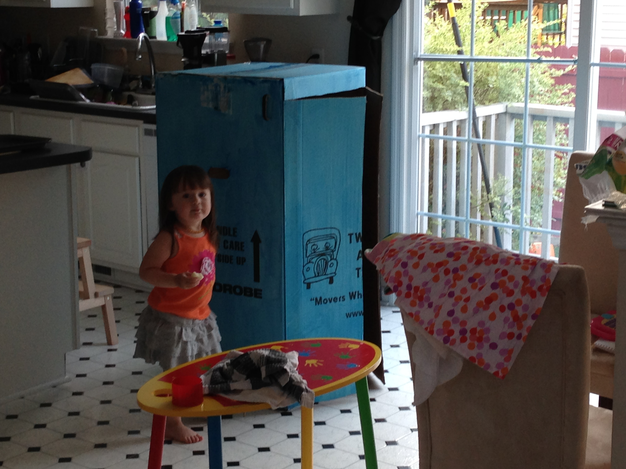 Our first coat dried WAY too light. I cut the doors early though so Penelope could start playing.