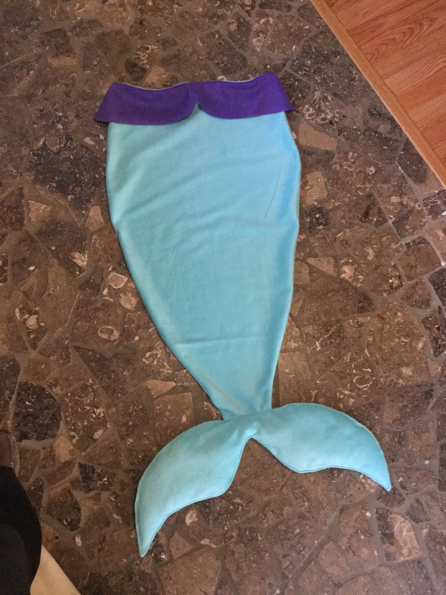Penelope's new mermaid tail blanket, made by Michelle (aka Mom, aka our sponsor)