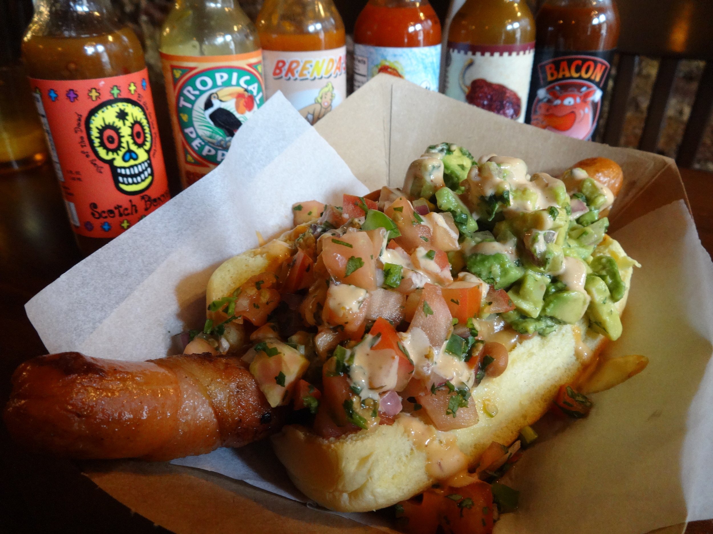 Sonoran  Hot   Dog  (Jumbo  hot   dog  wrapped in bacon, topped with beans, guacamole, pico sauce and chipotle aioli)