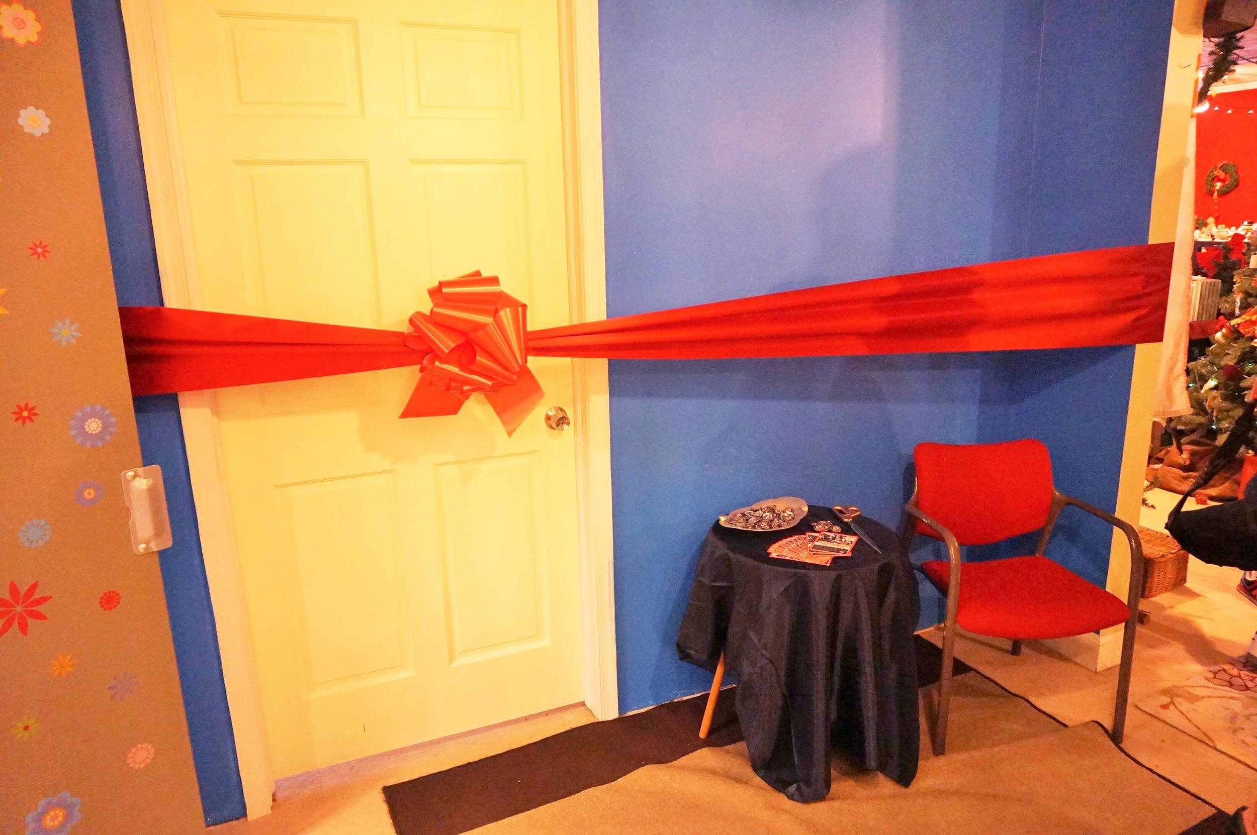 Ribbon ready to be cut on new HIV testing center.JPG