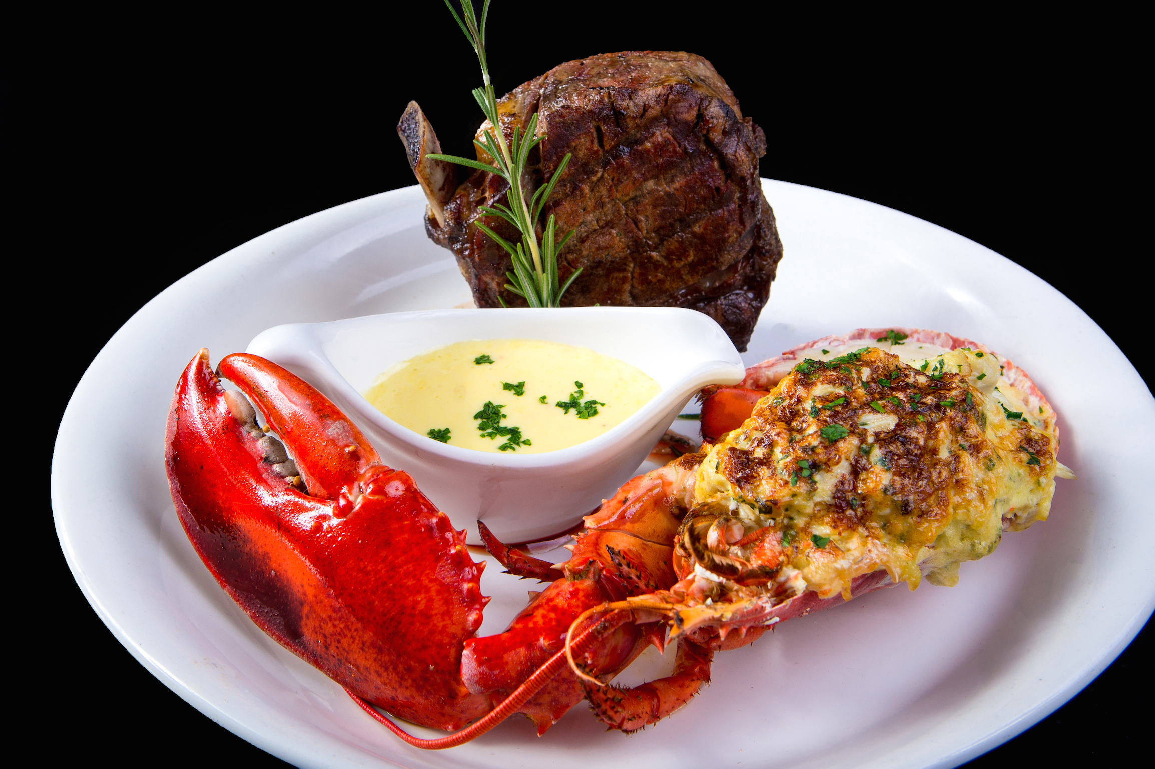 Surf and Turf, Bone-In Filet Mignon, Lobster Stuffed with Jumbo Lump Crab Béarnaise-Glaçage.jpg