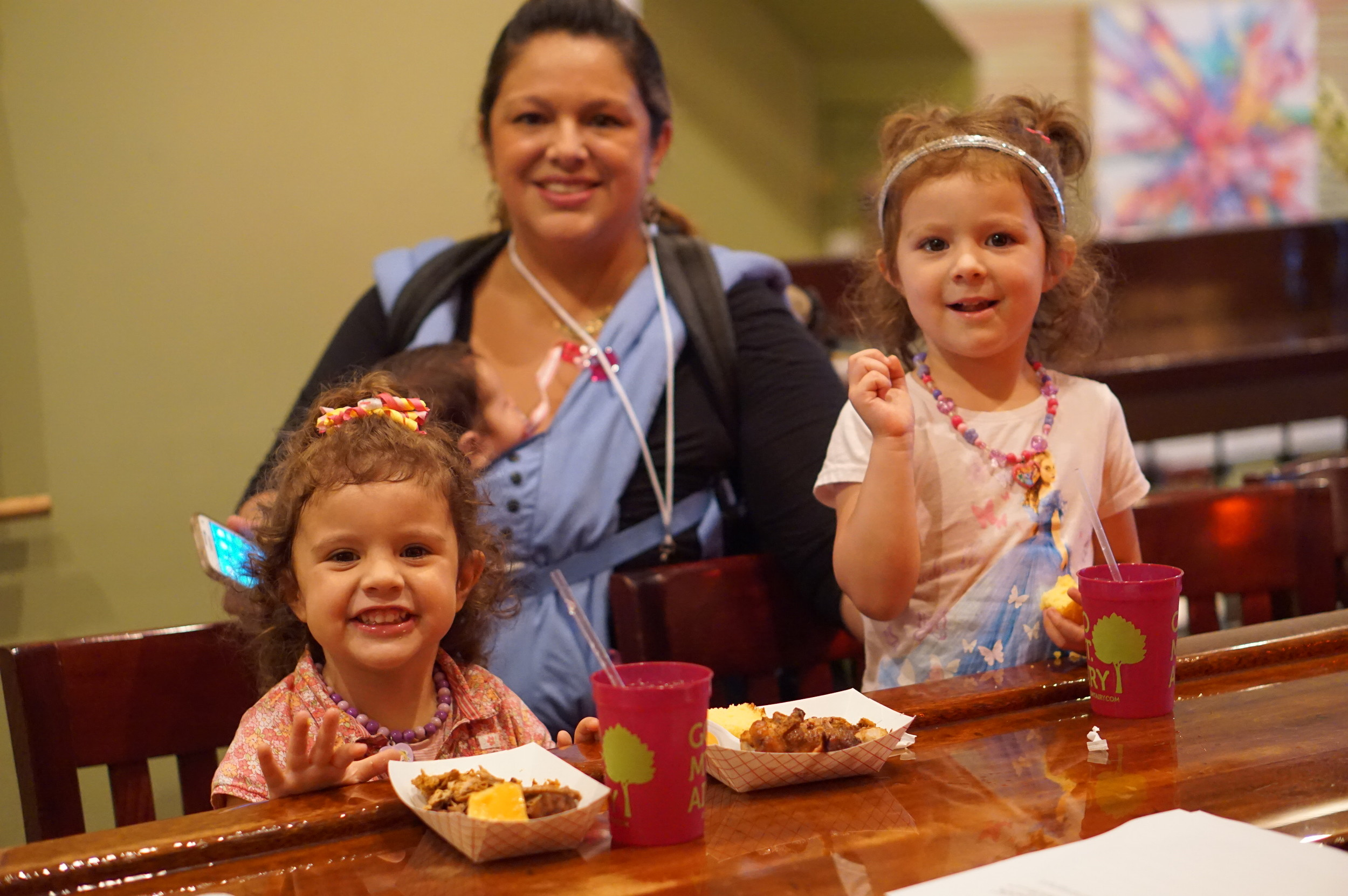Noelle Kelly and her two little ones enjoy tasty bites on the Street Fare media preview.JPG