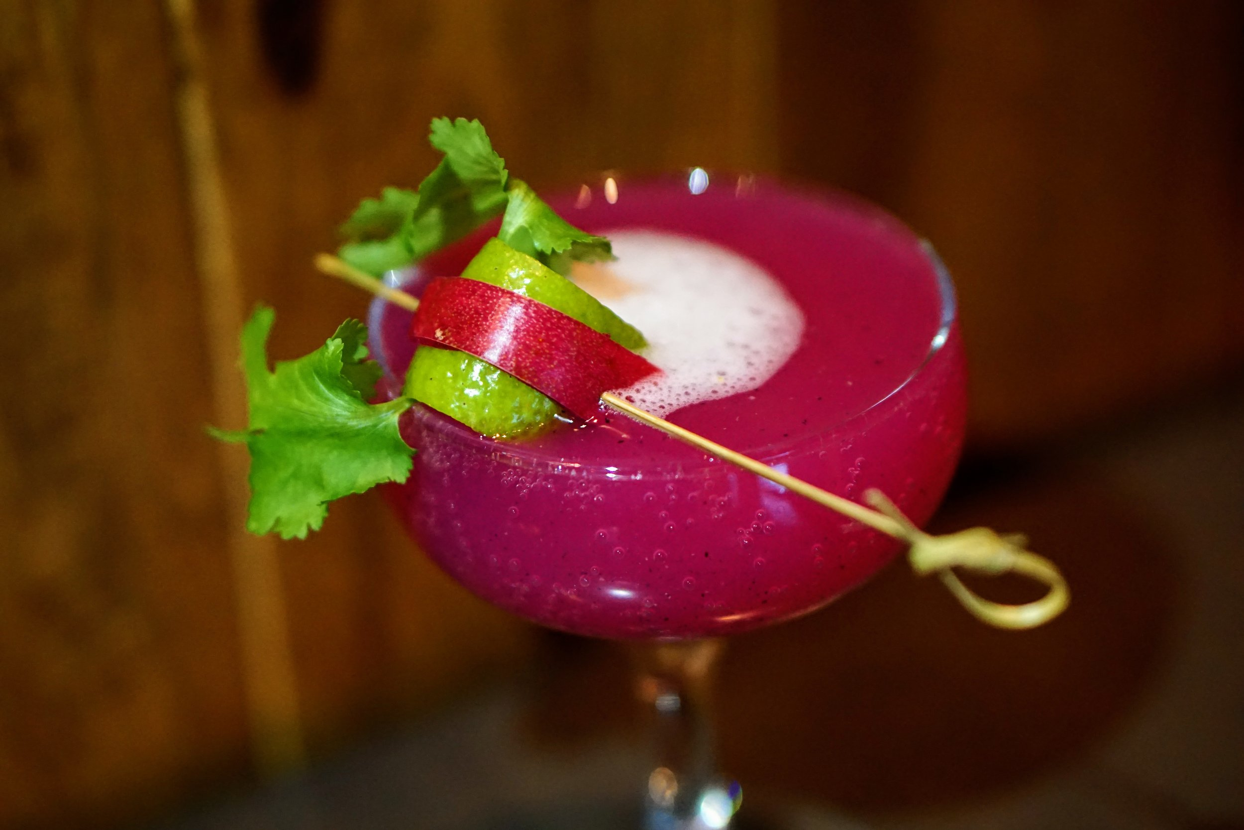 Kimberly Shurig - Fine Palate Mother of the Dragon  Tequila and dragon fruit with a hint of habanero-infused simple syrup over fresh ice garnished with lime peel dragon fruit skin and cilantro.