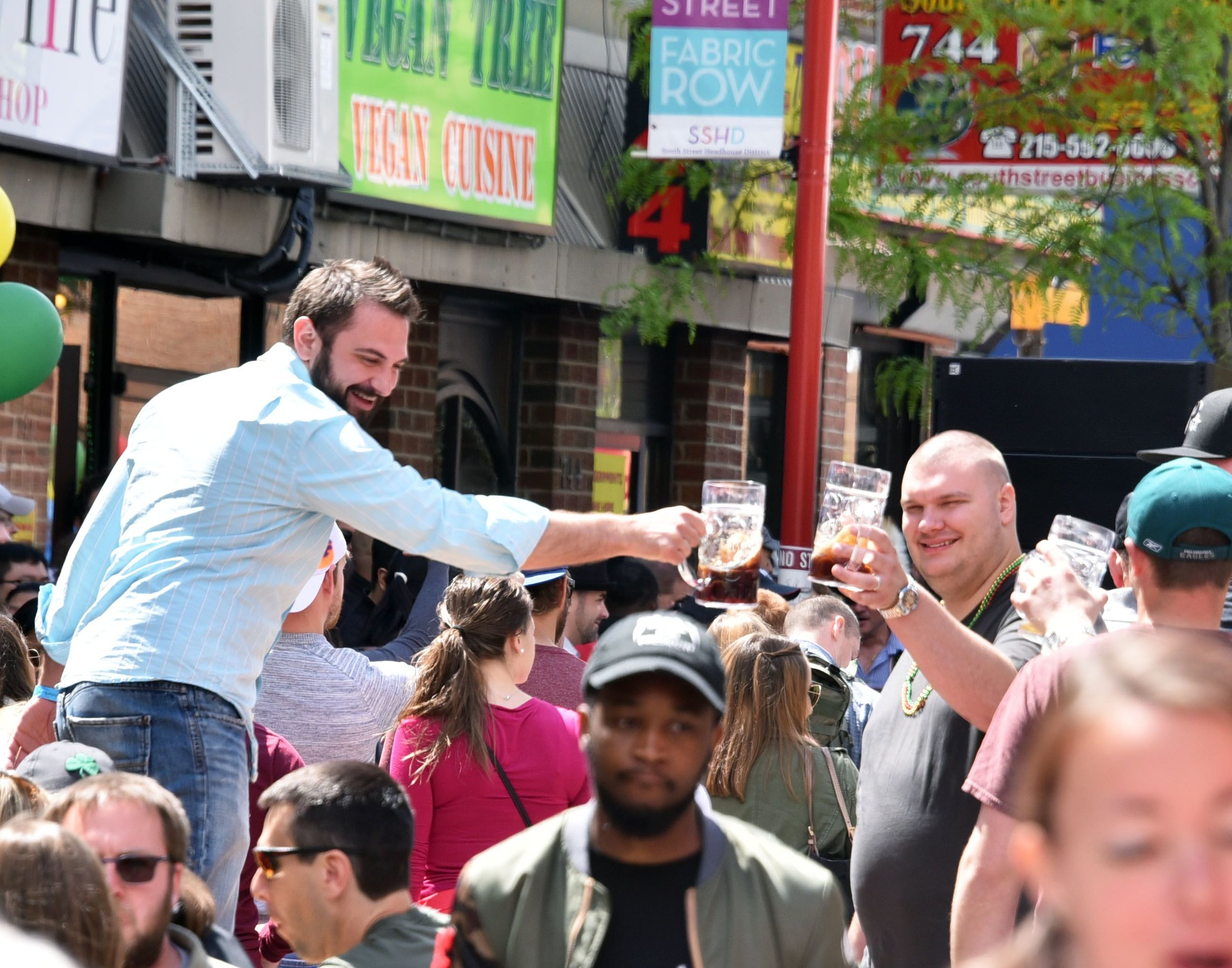 Festival Patrons Clinking Beer Steins at Maifest 2018