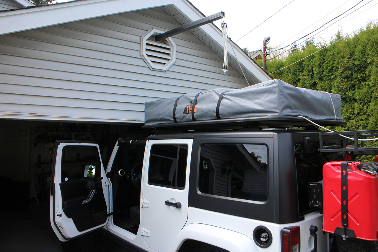 Tent Lifted via Pulleys onto Jeep for the First Time