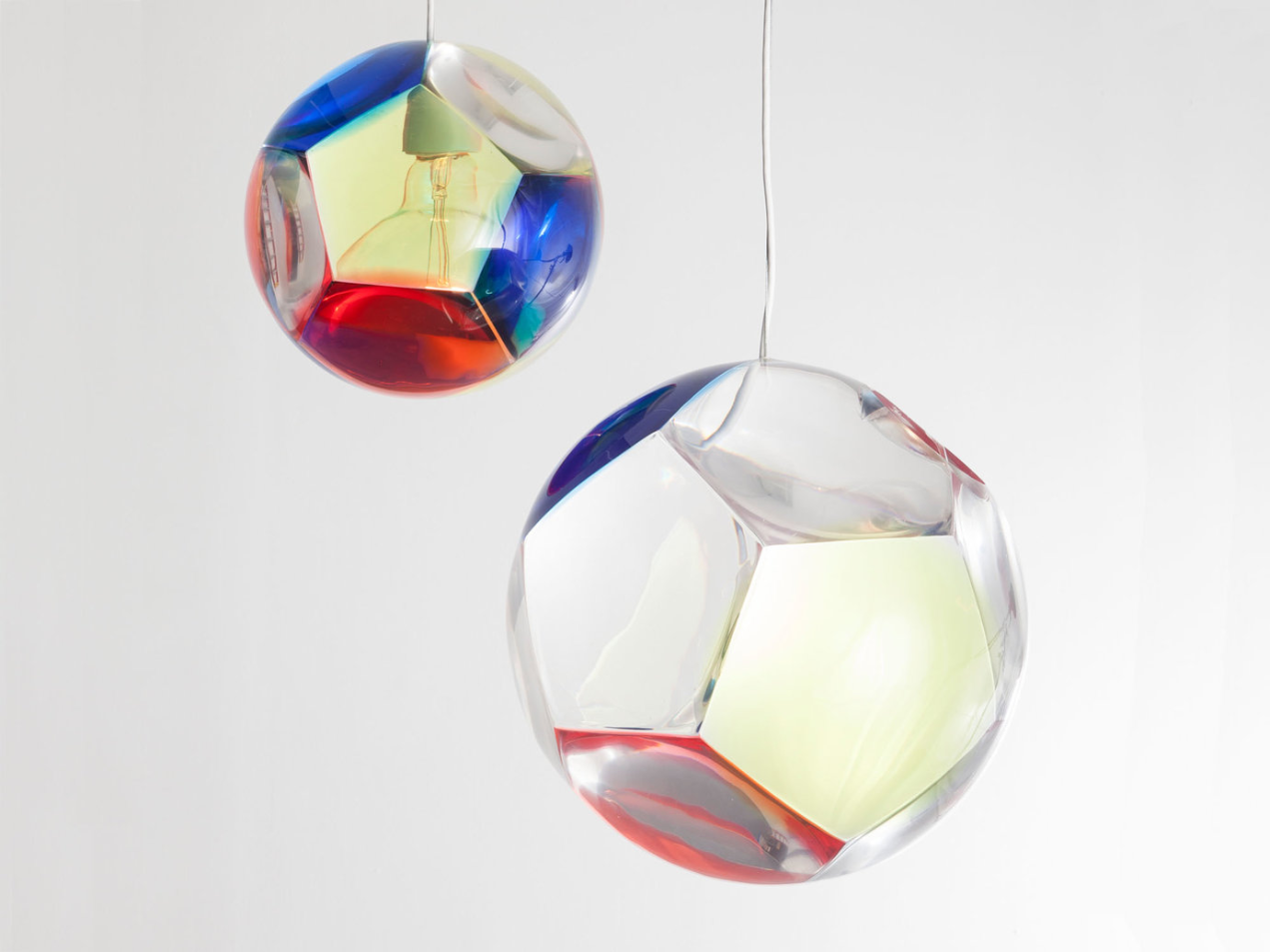 """Medium """"Dodecahedron"""" chandelier and optical instrument with three yellow lenses, three blue lenses, three red lenses, and three clear lenses, in poured polyurethane resin. Edition 1 of 9 with 2 APs. 14"""" D / 35.56cm D."""