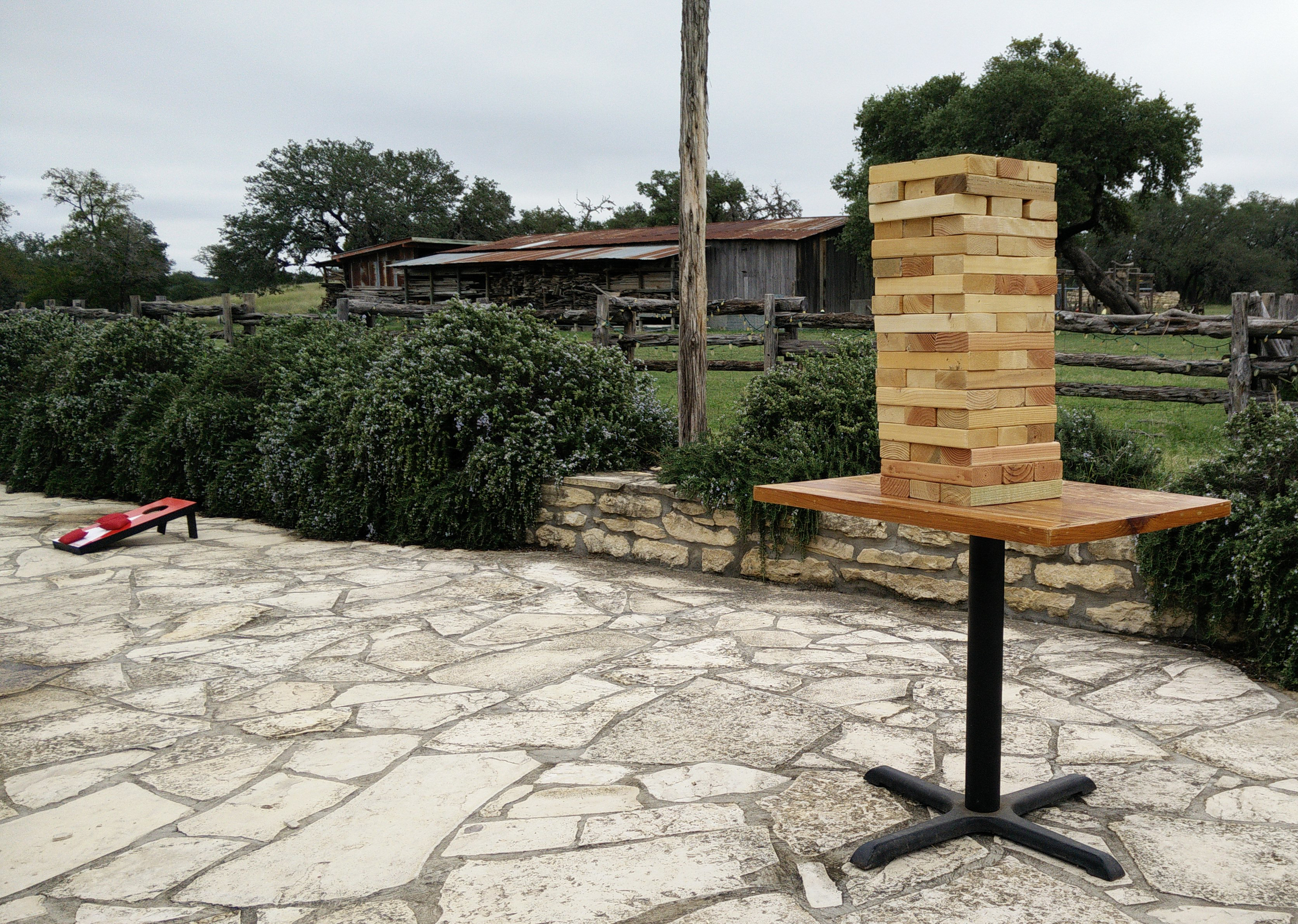 Giant Jenga, with Bags/Cornhole in the background.