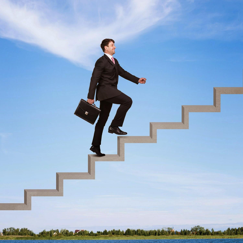 Businessman walking upstairs (iStockPhoto)