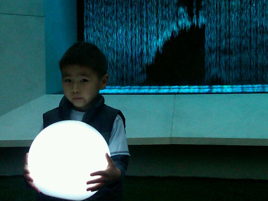 little asian boy with orb_sm copy.jpg