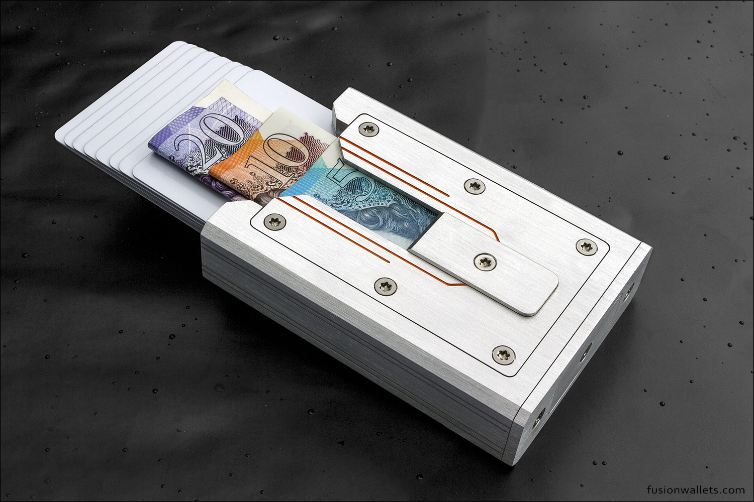 Orange engrave with cash and cards.jpg