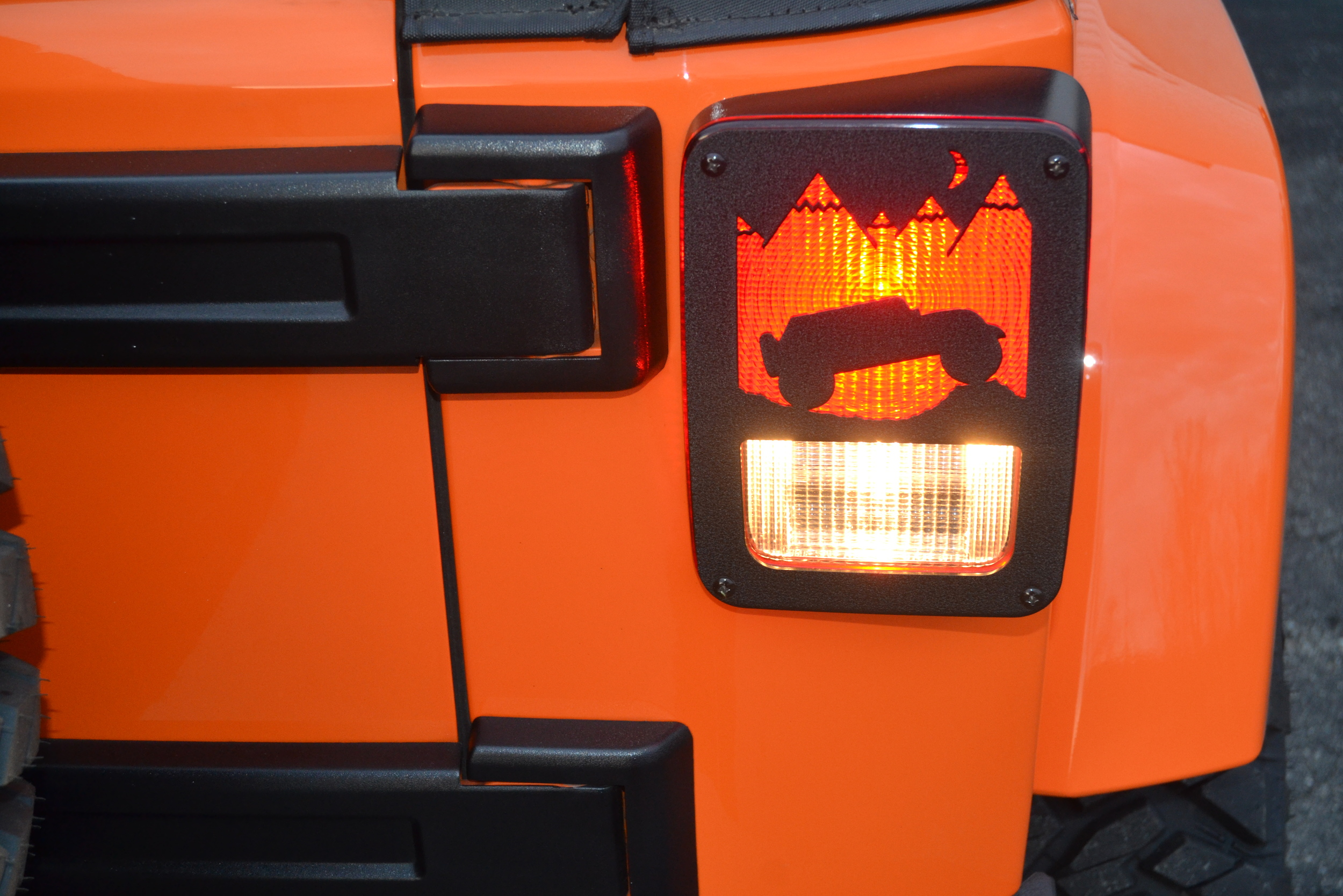 BLACK JK (2007-PRESENT) JEEP TERRAIN DESIGN SHOWN ABOVE. NEW DESIGN. ALL OUR TAILLIGHT GUARDS ARE REVERSABLE. JEEP IMAGE CAN FACE OUTWARDS OR TOWARDS EACH OTHER.