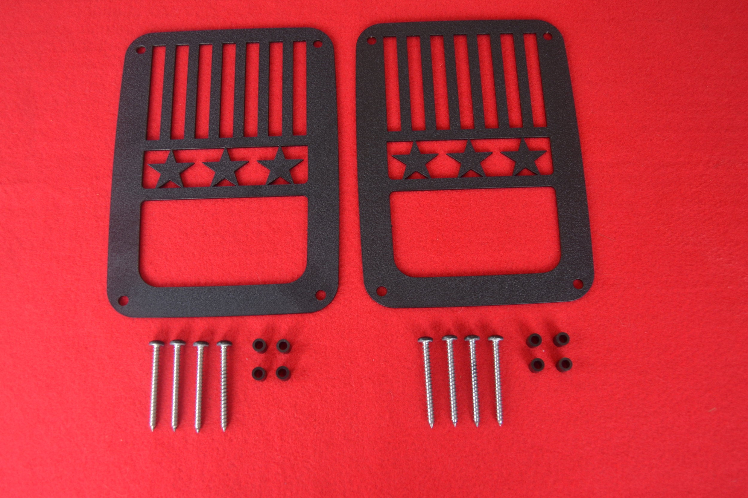 BLACK JK (2007-PRESENT) JEEP STARS & STRIPES DESIGN SHOWN ABOVE.THIS TAILLIGHT GUARD IS REVERSABLE.