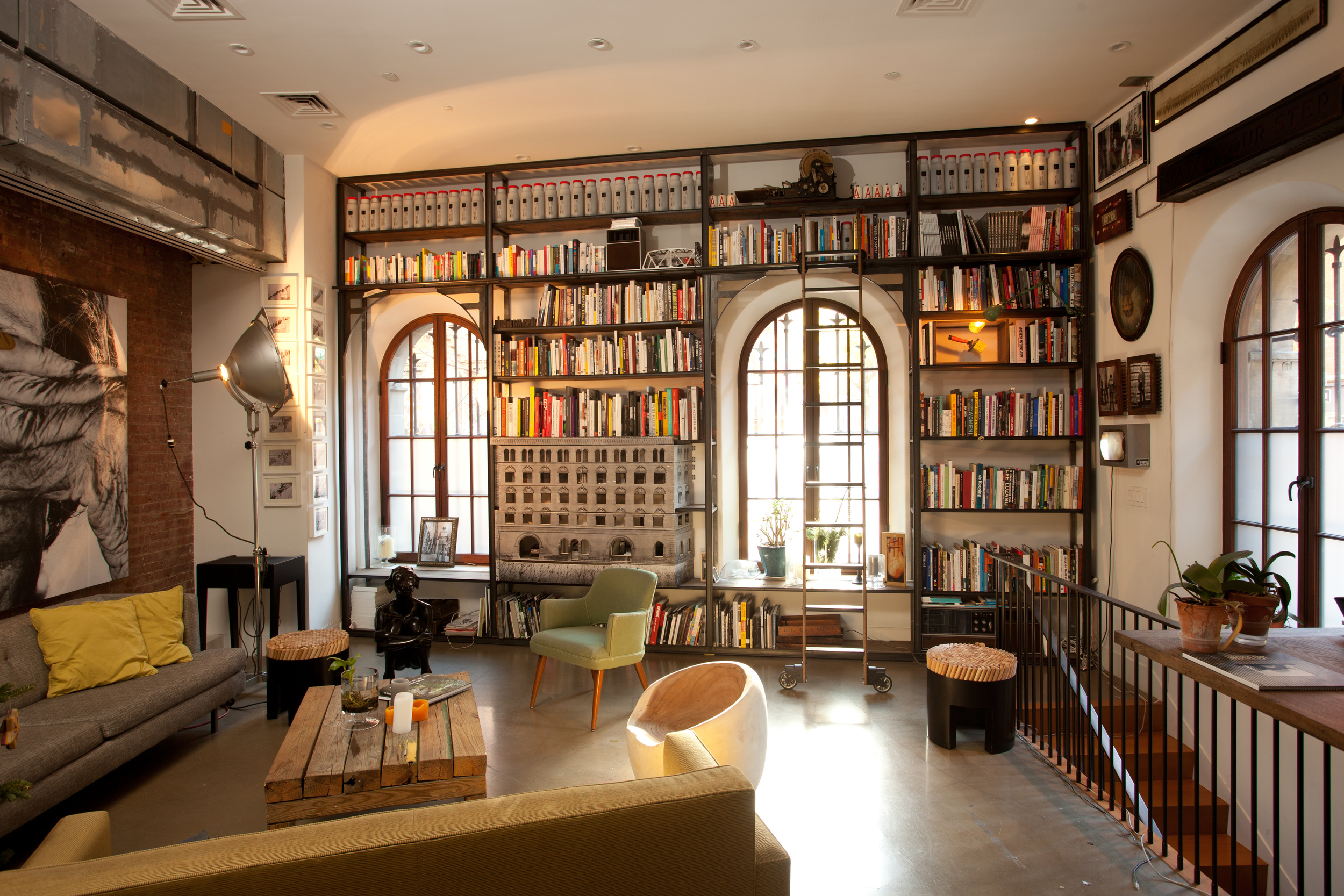 SoHo Loft  Library wall with reclaimed ladder